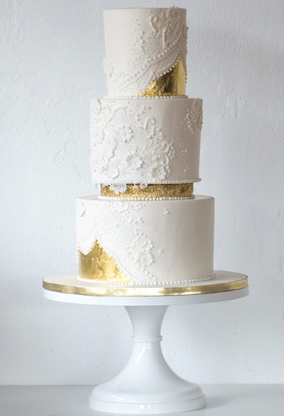 Luxe white wedding cake with gold specks