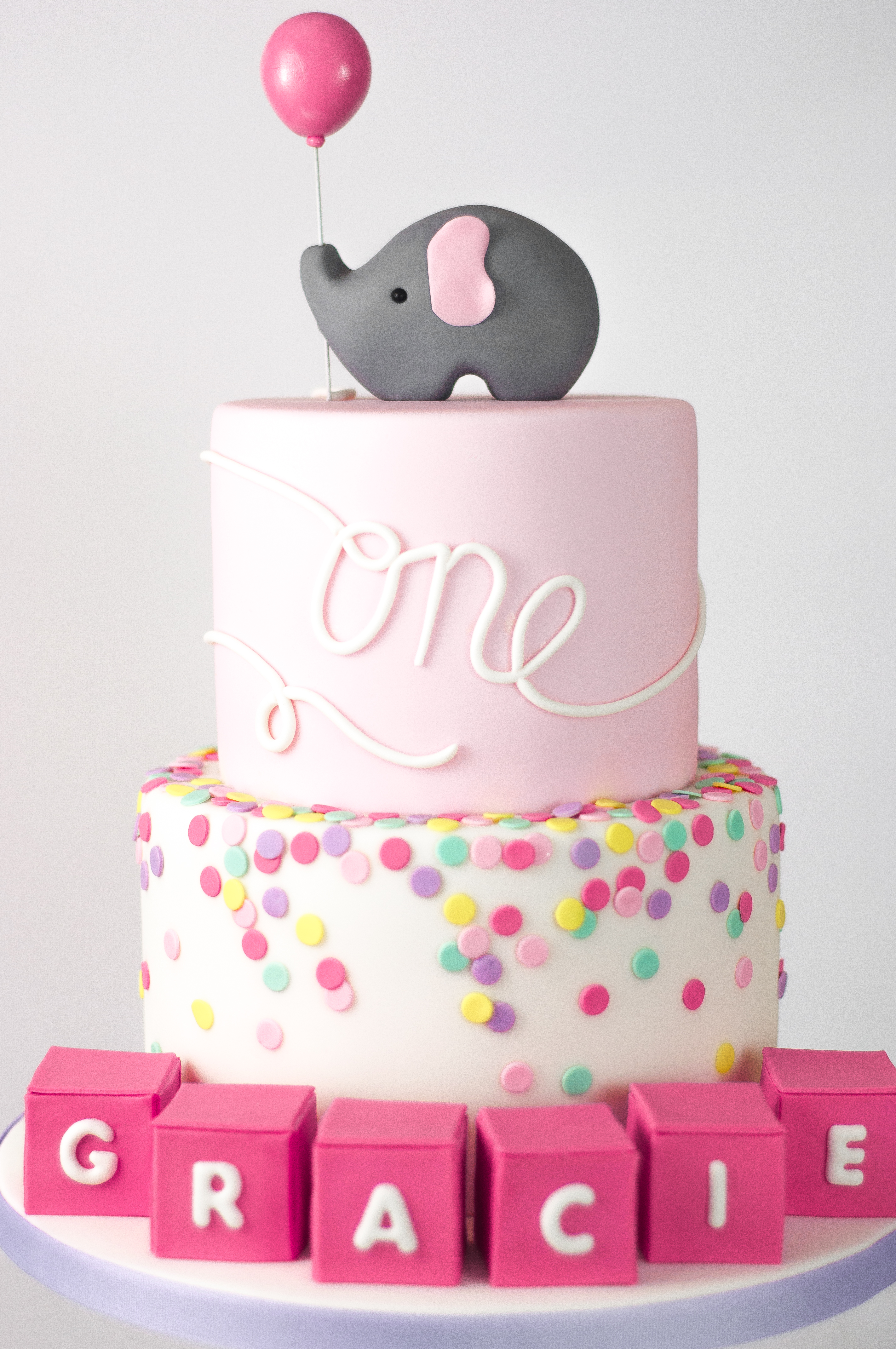 Pink and white baby elephant cake