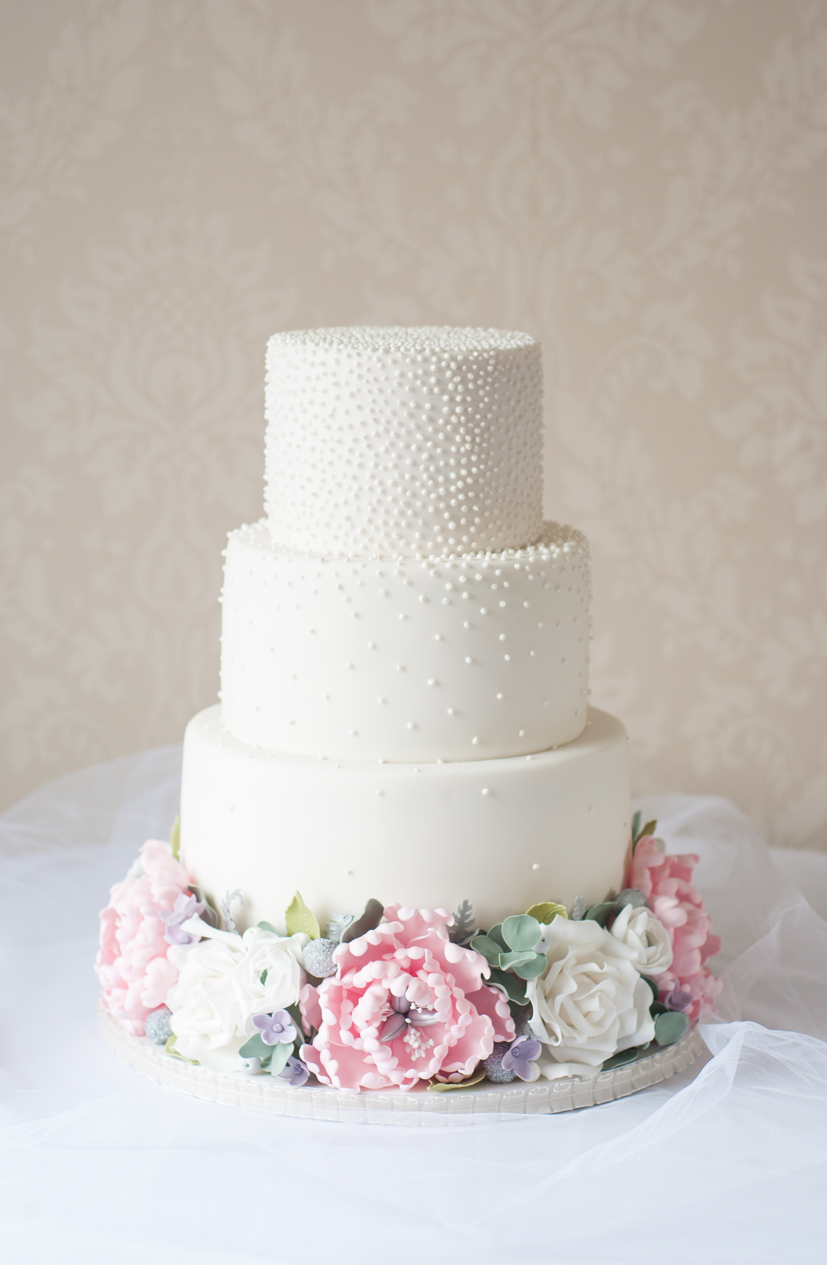 Blush peony floral crown wedding cake with piped pearls
