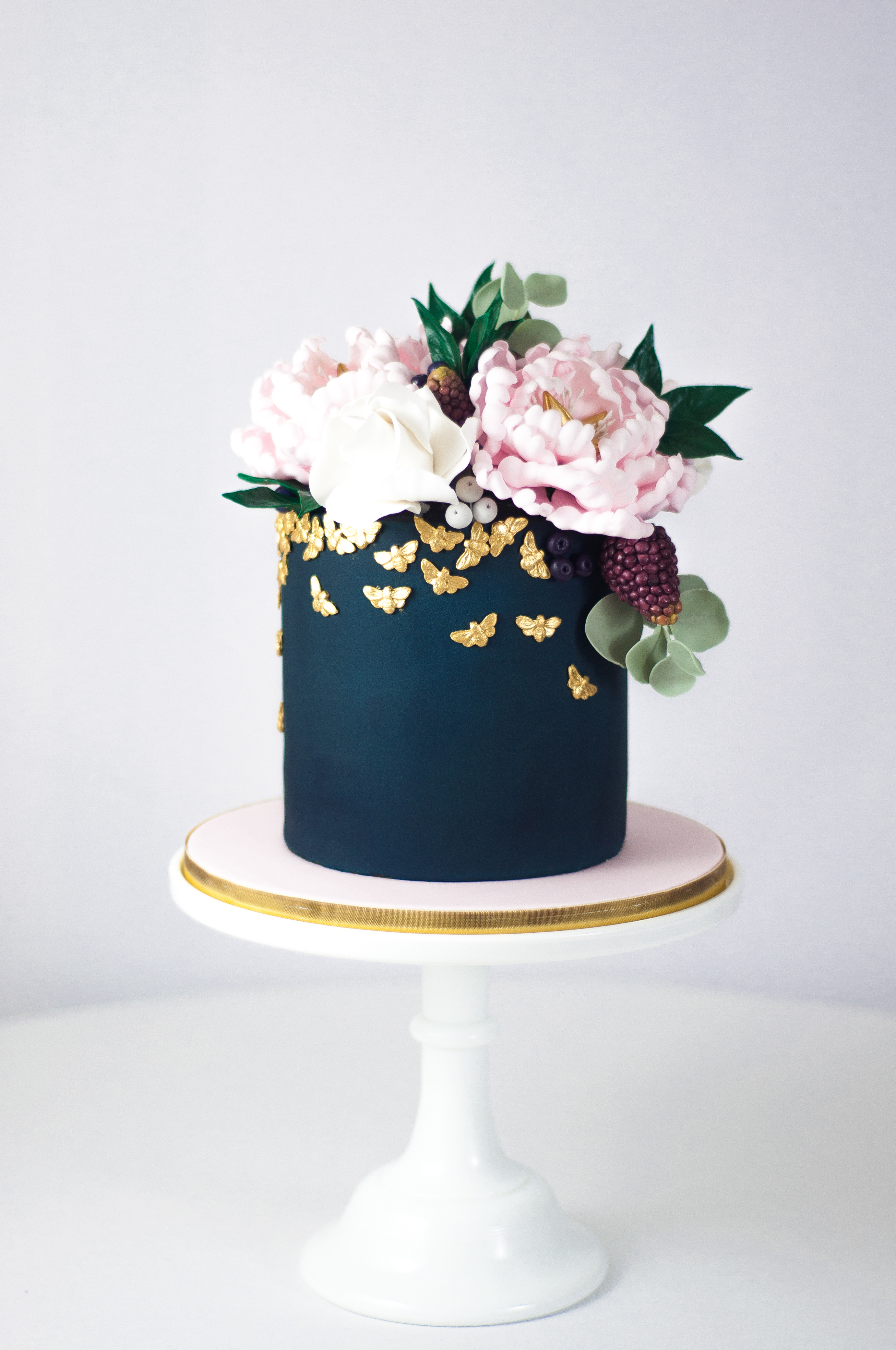 Blush peony navy blue with gold wedding cake