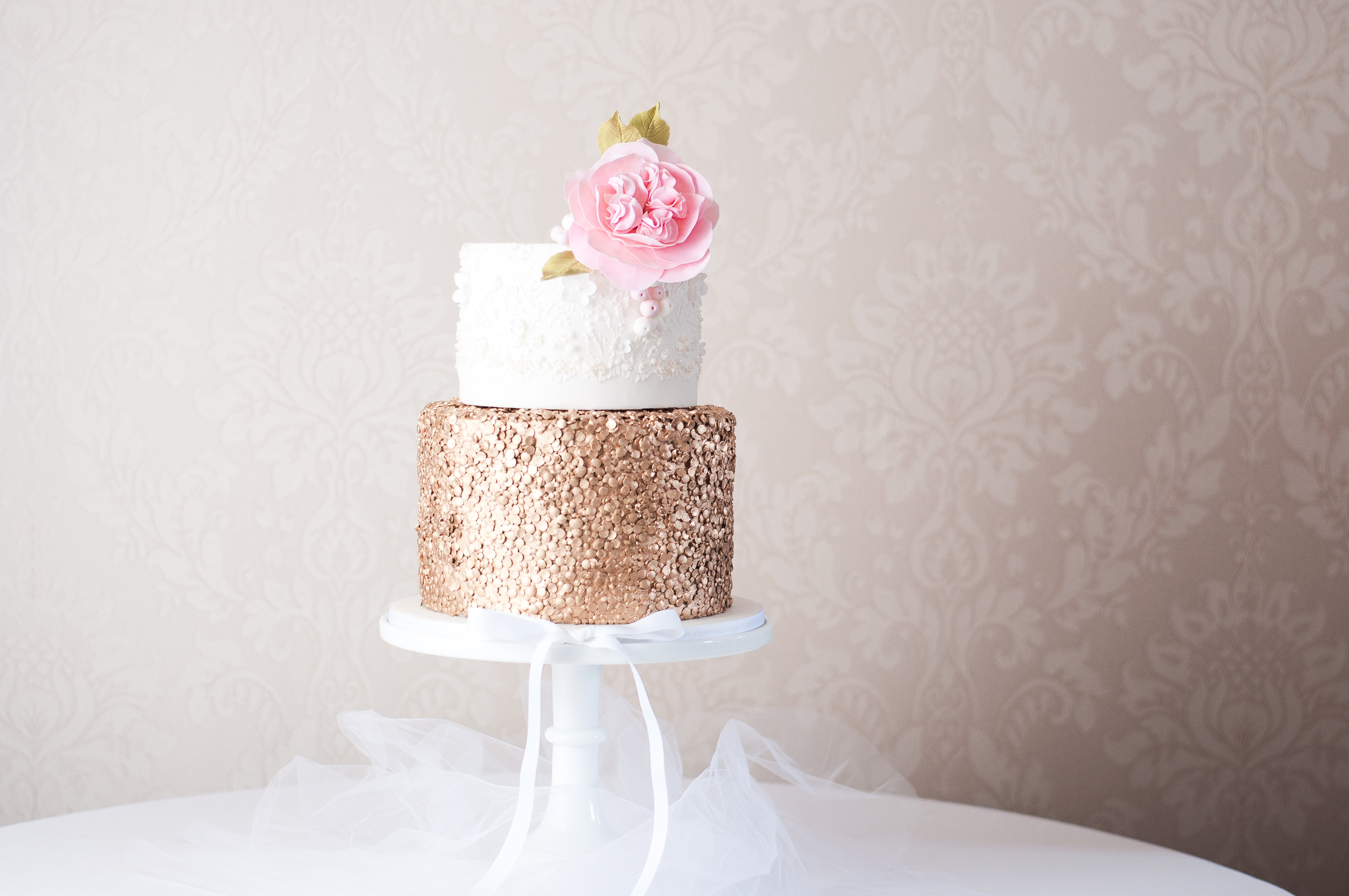 Gold sequin and lace fondant wedding cake