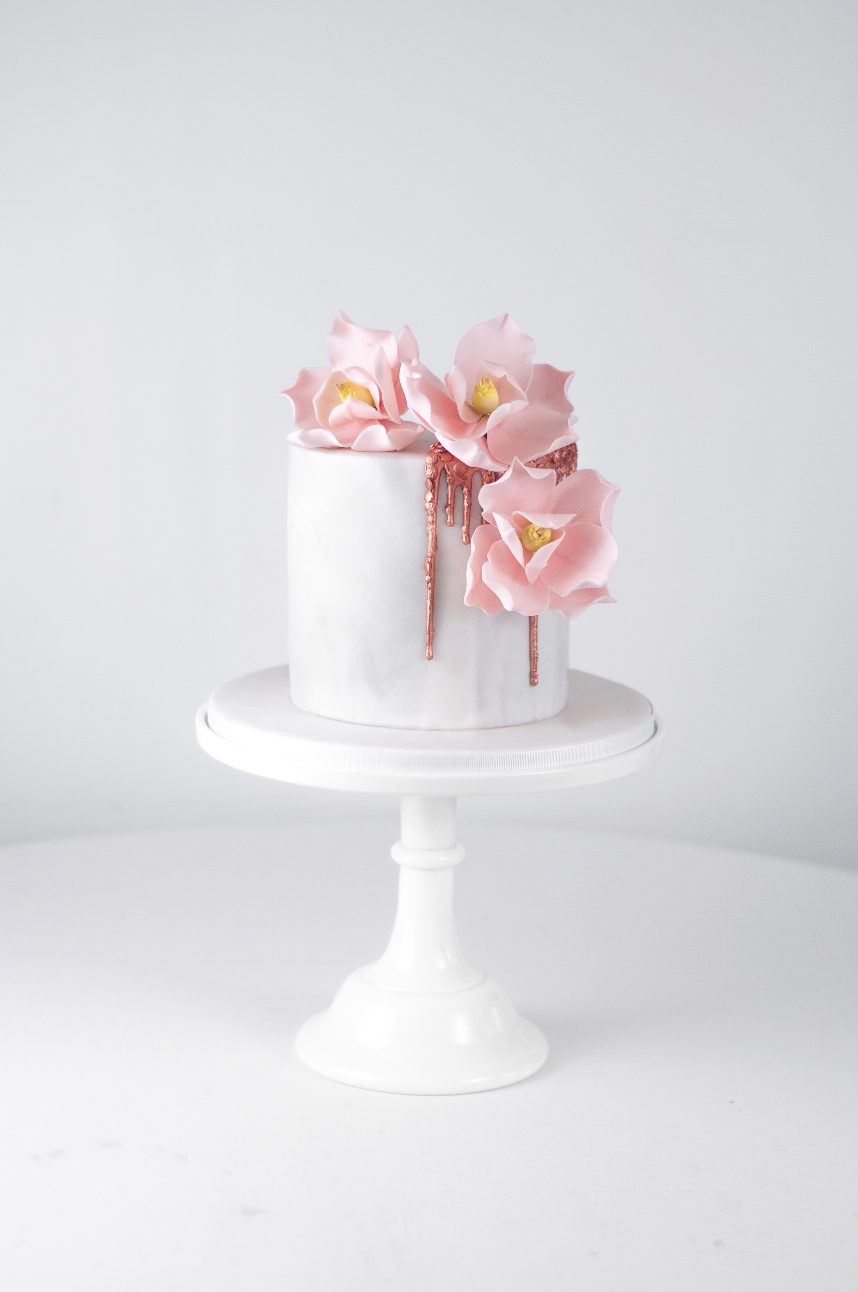 Marble and rose gold magnolia cake