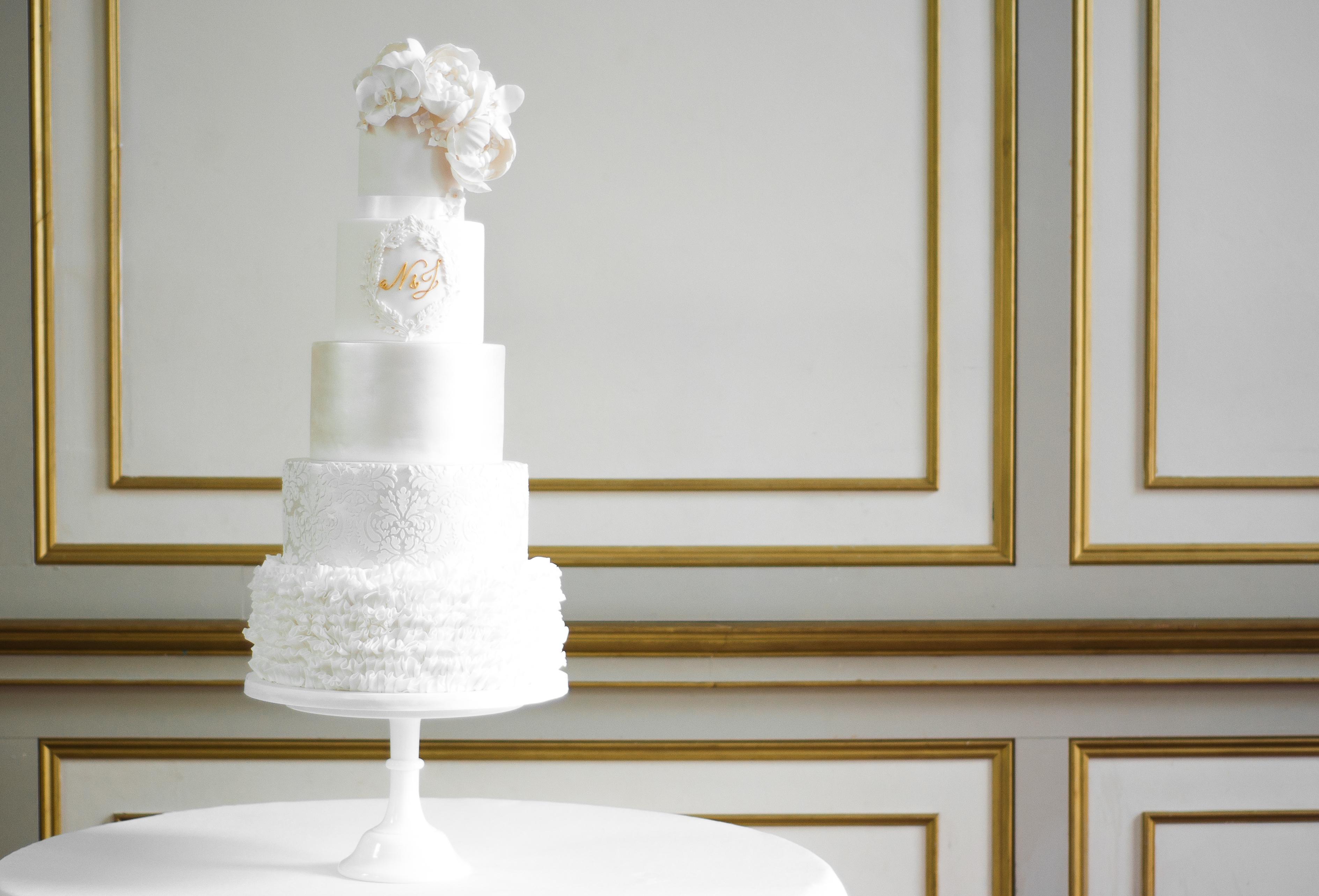 White ruffle monogramed wedding cake