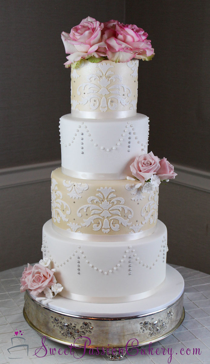 Ivory and white wedding cake with sugar roses