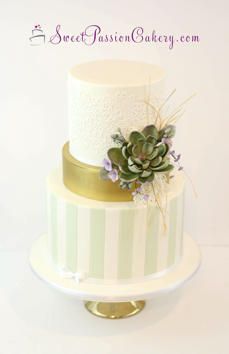 Pastel green and white striped wedding cake