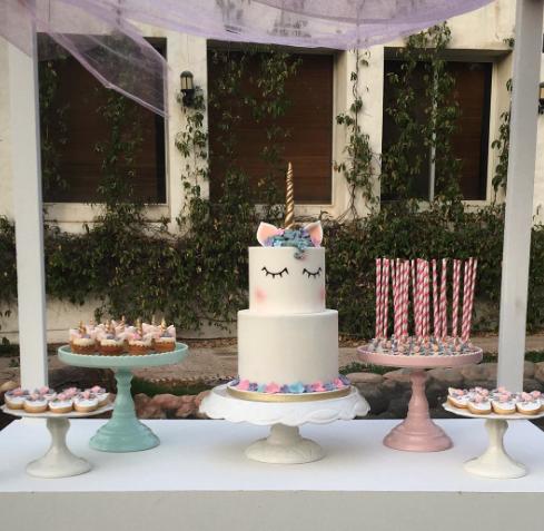 White fondant unicorn birthday cake