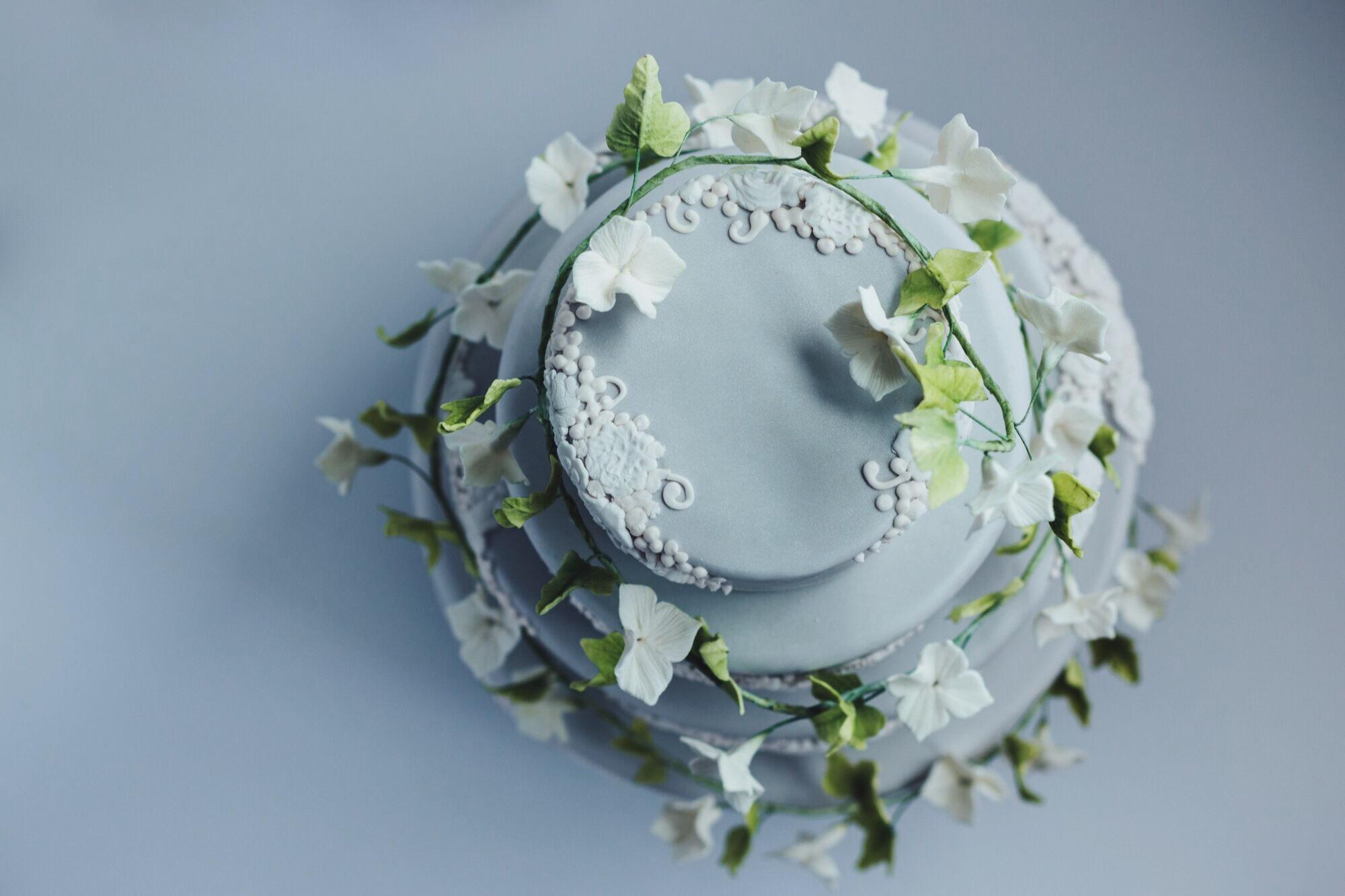 Gray wedding cake with cascading sugar flowers