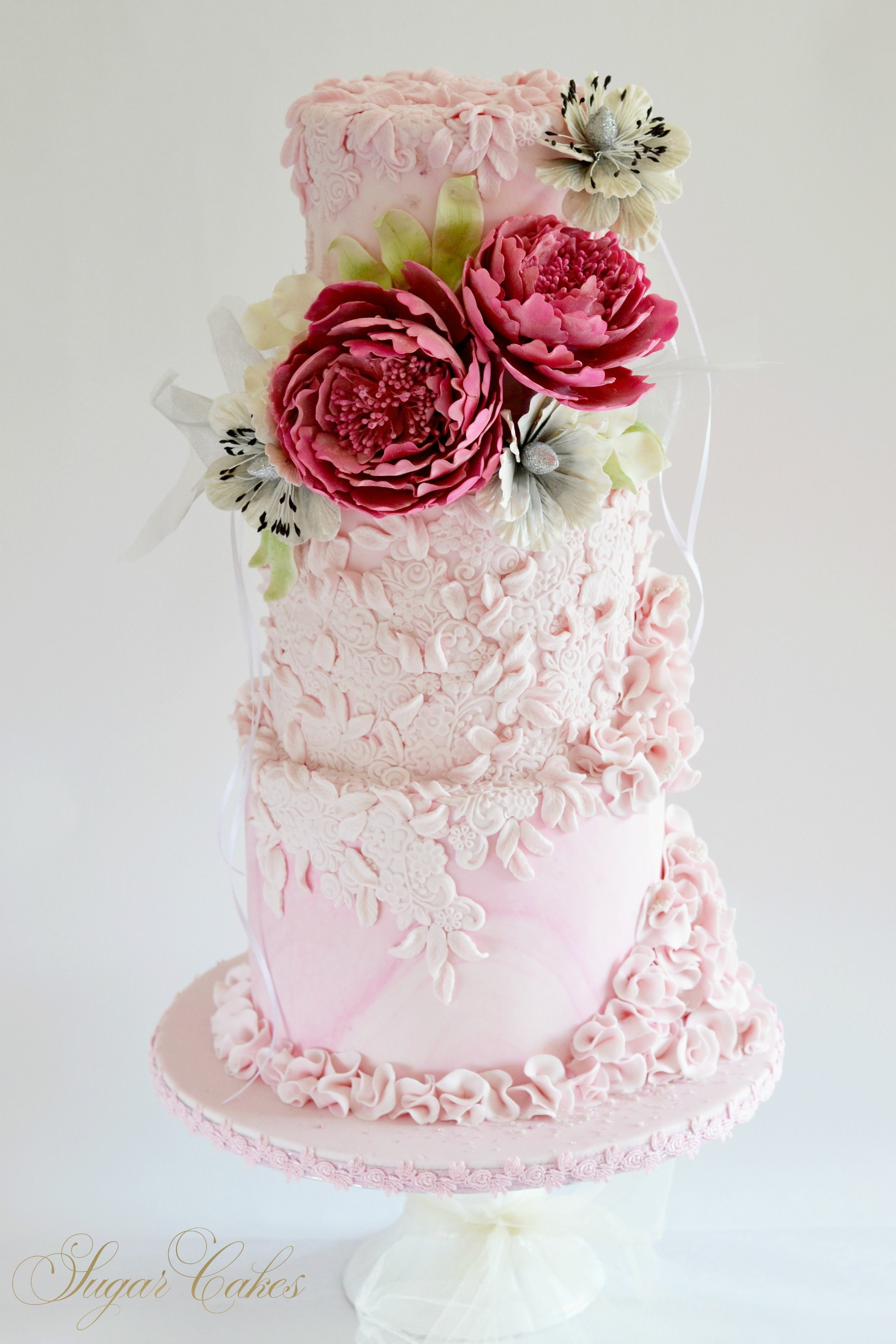 All baby pink wedding with dark pink sugar roses