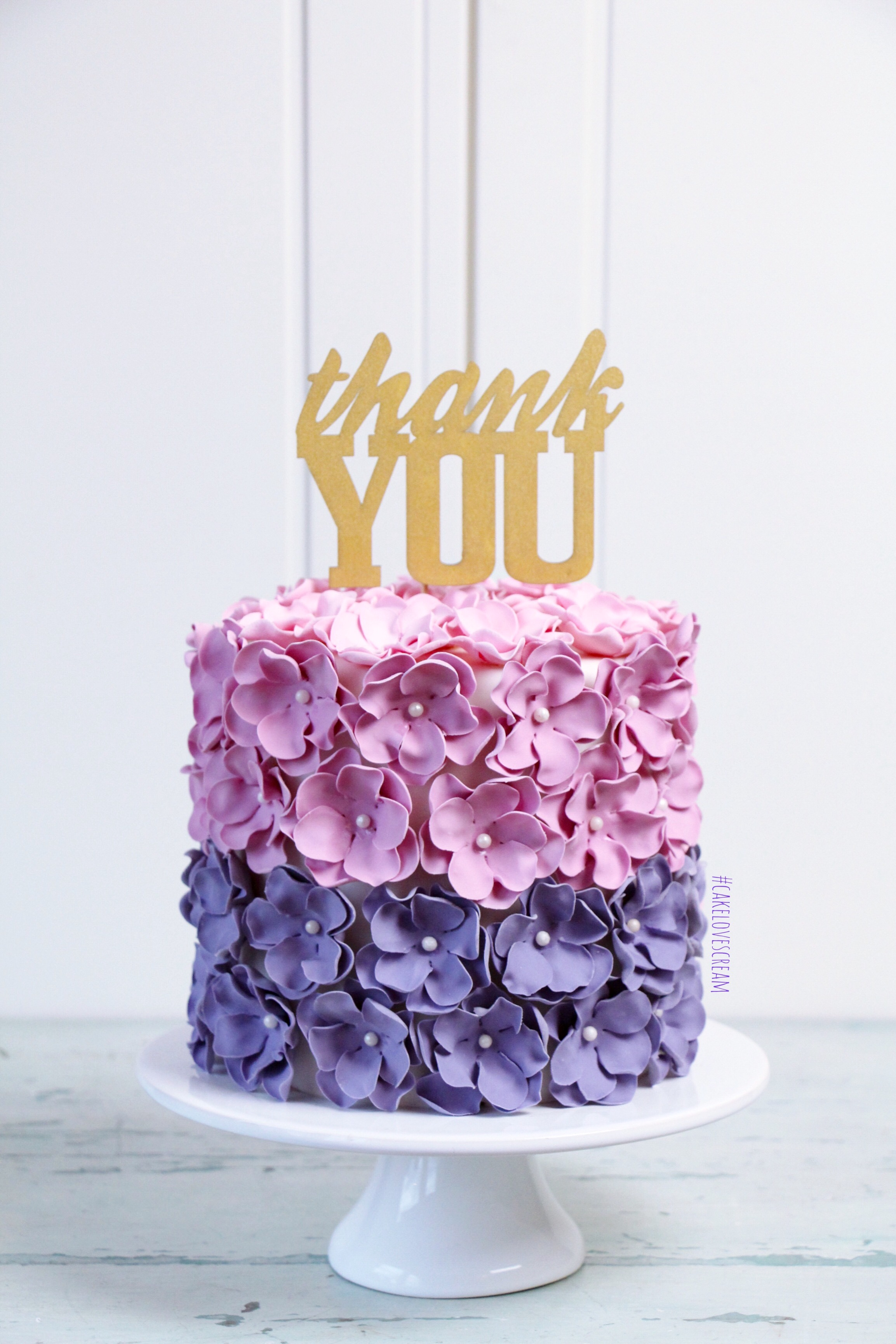 Pink and purple flower petal fondant cake