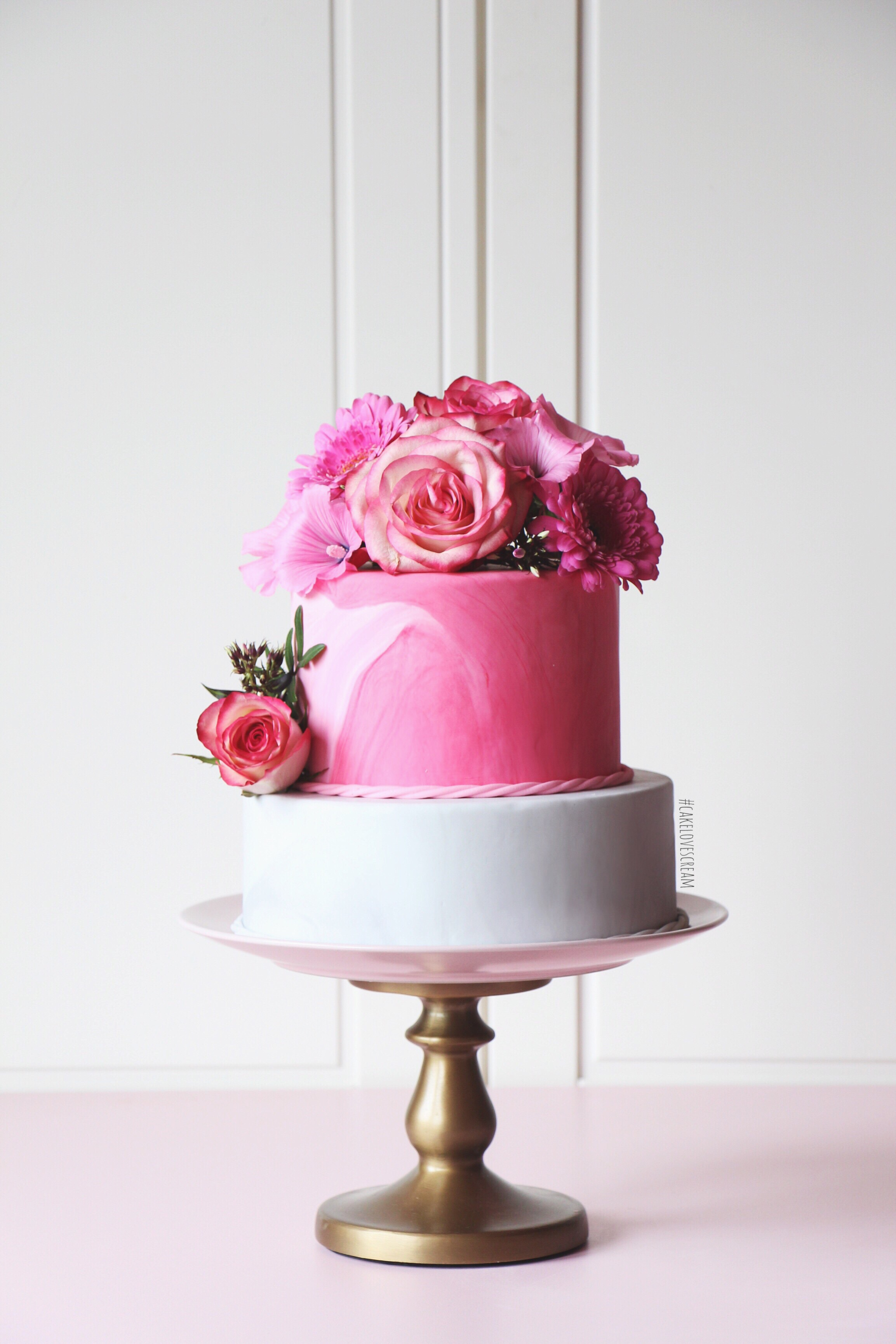 Pink marbled wedding cake with gray and sugar roses