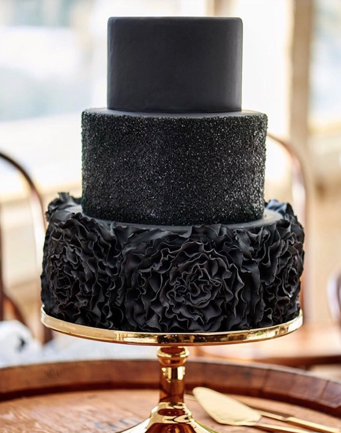 All black textured wedding cake with ruffles