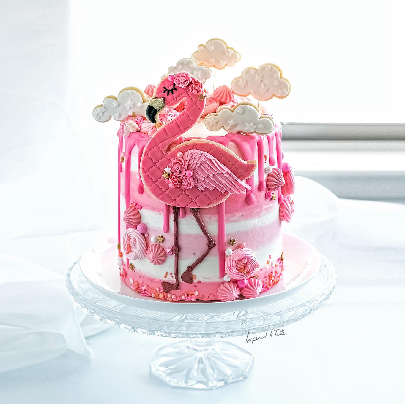 Pink and white flamingo birthday cake