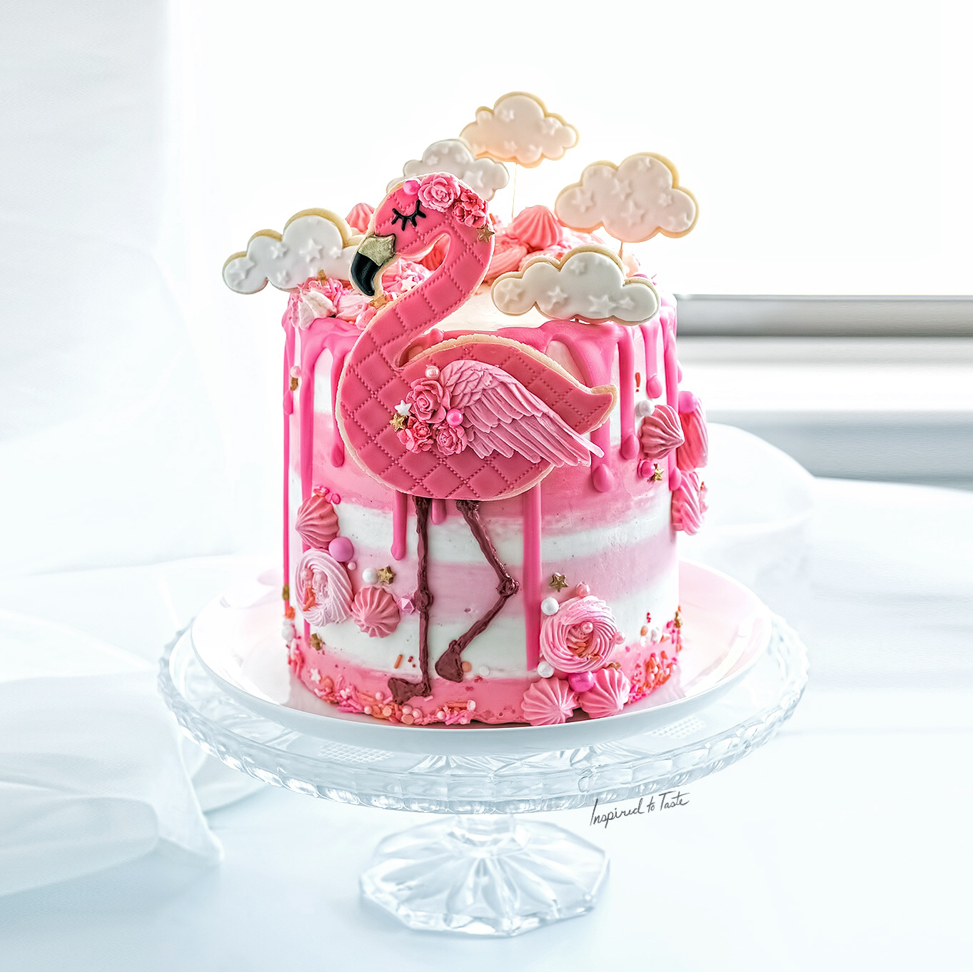 Pink and white flamingo birthday cake