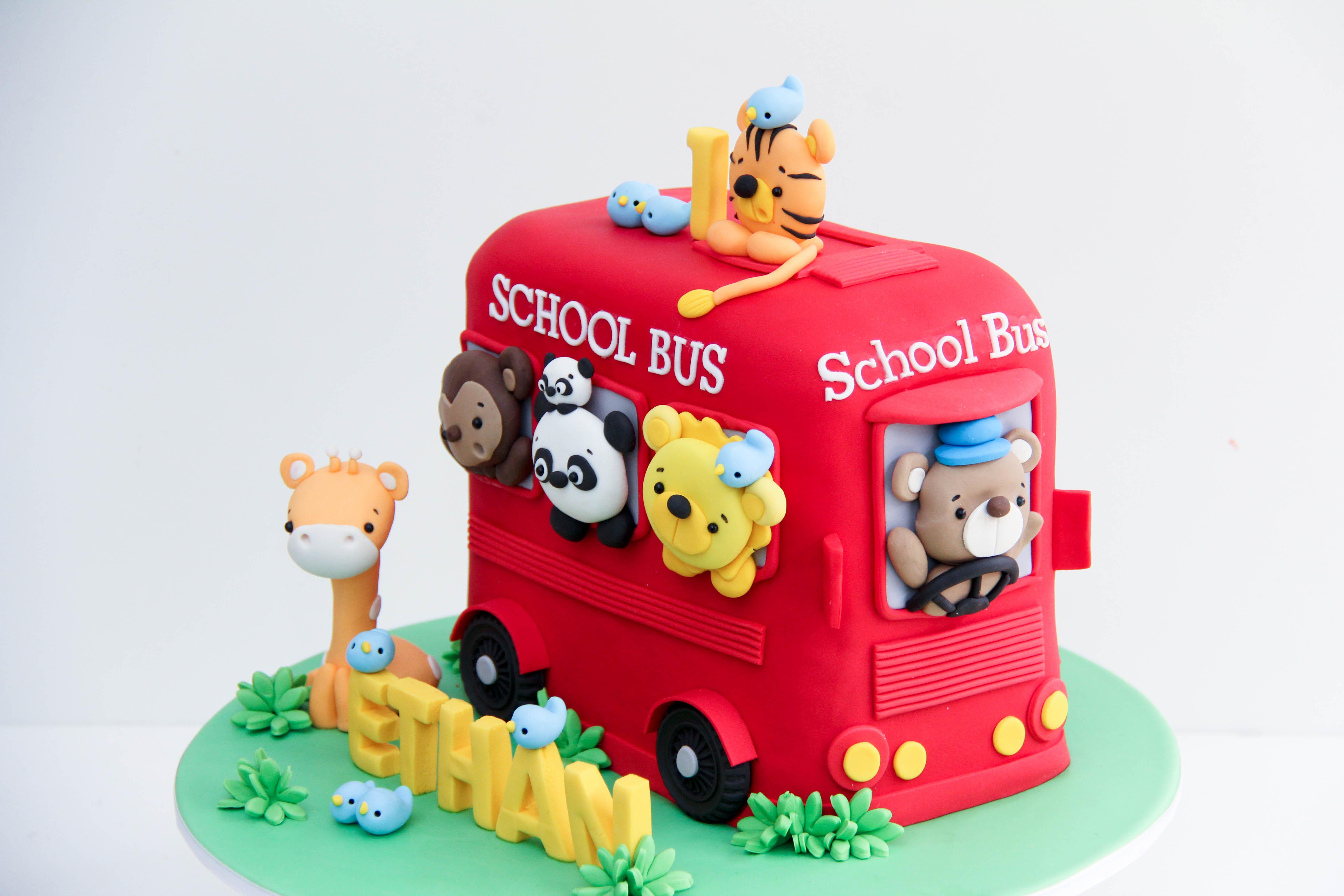 Animal school bus birthday cake