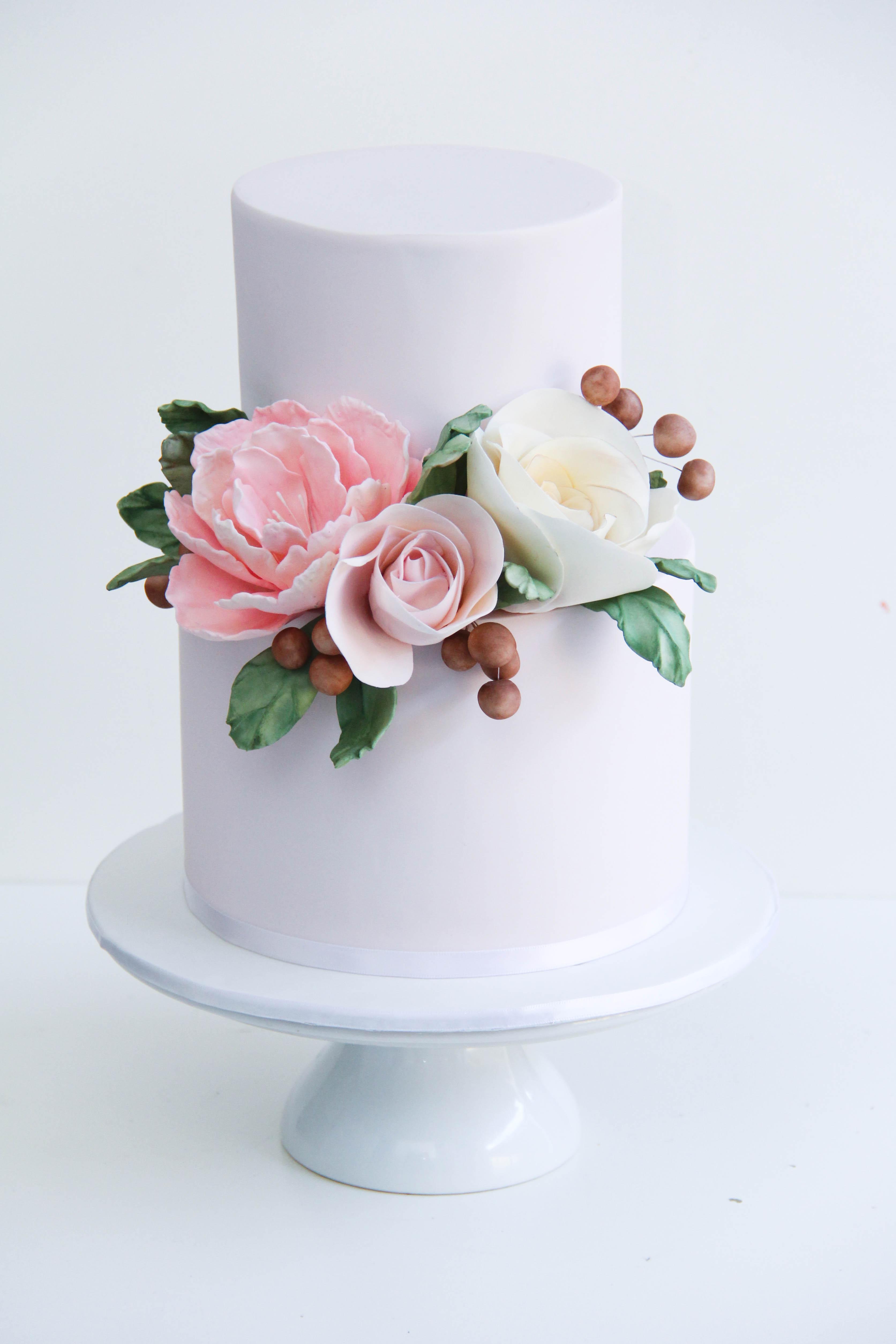 White wedding with sugar flower wreath
