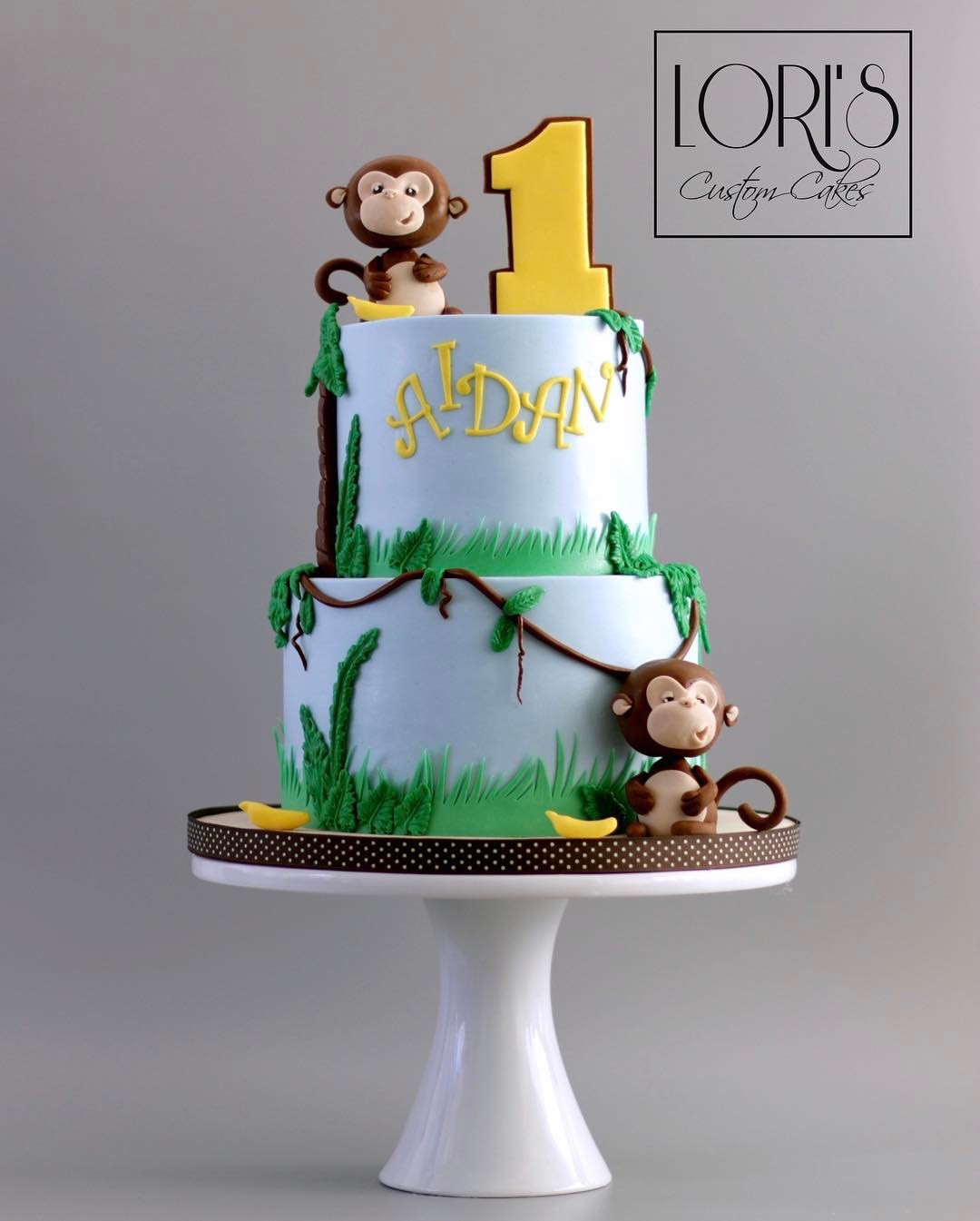 Blue and green monkey first birthday cake