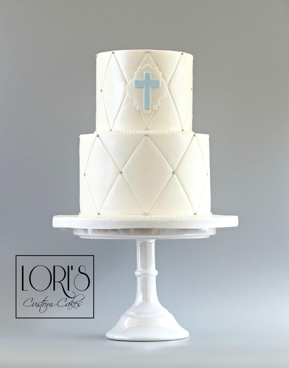 White with blue baptism cake