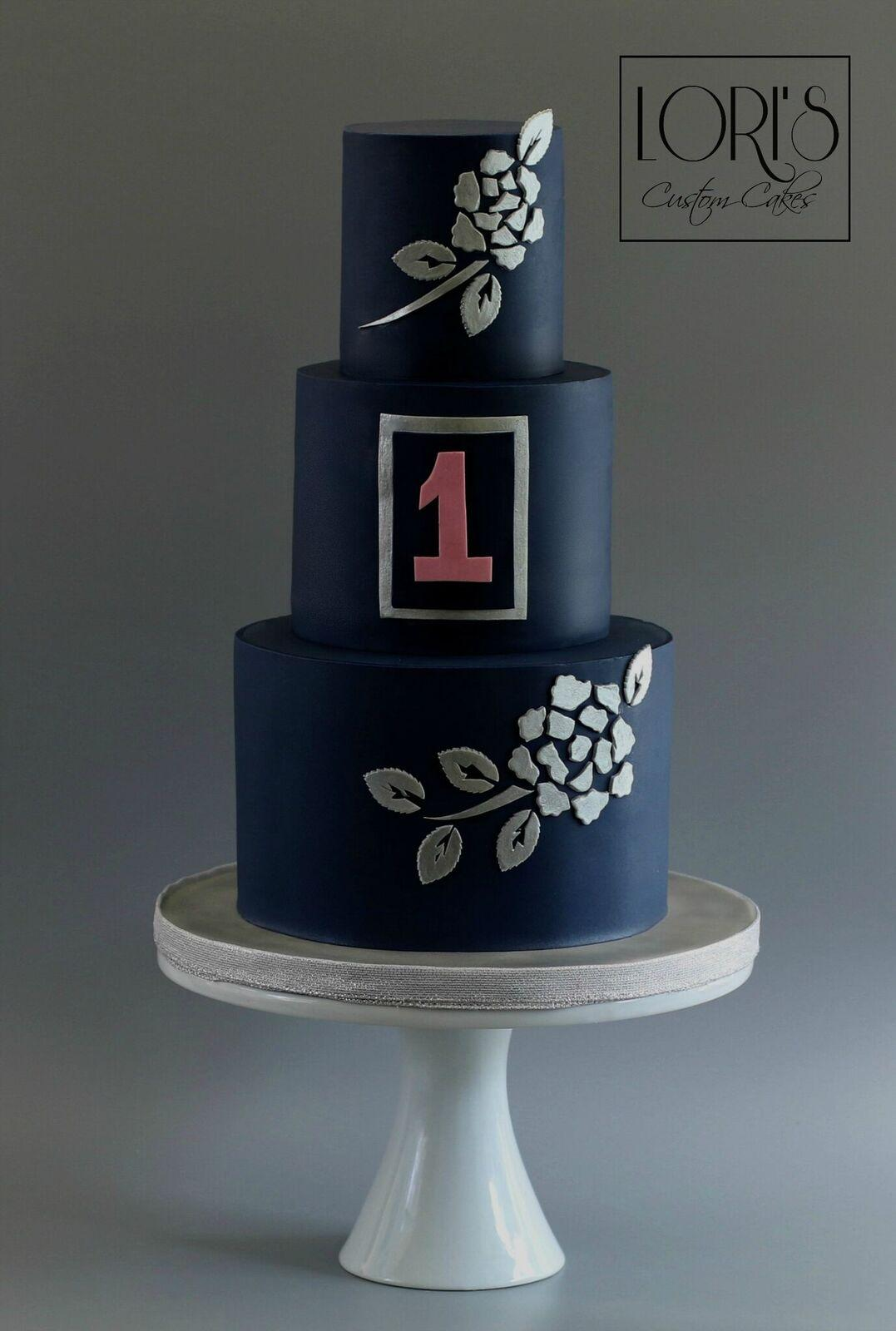 Navy blue cake with silver hand painted flowers