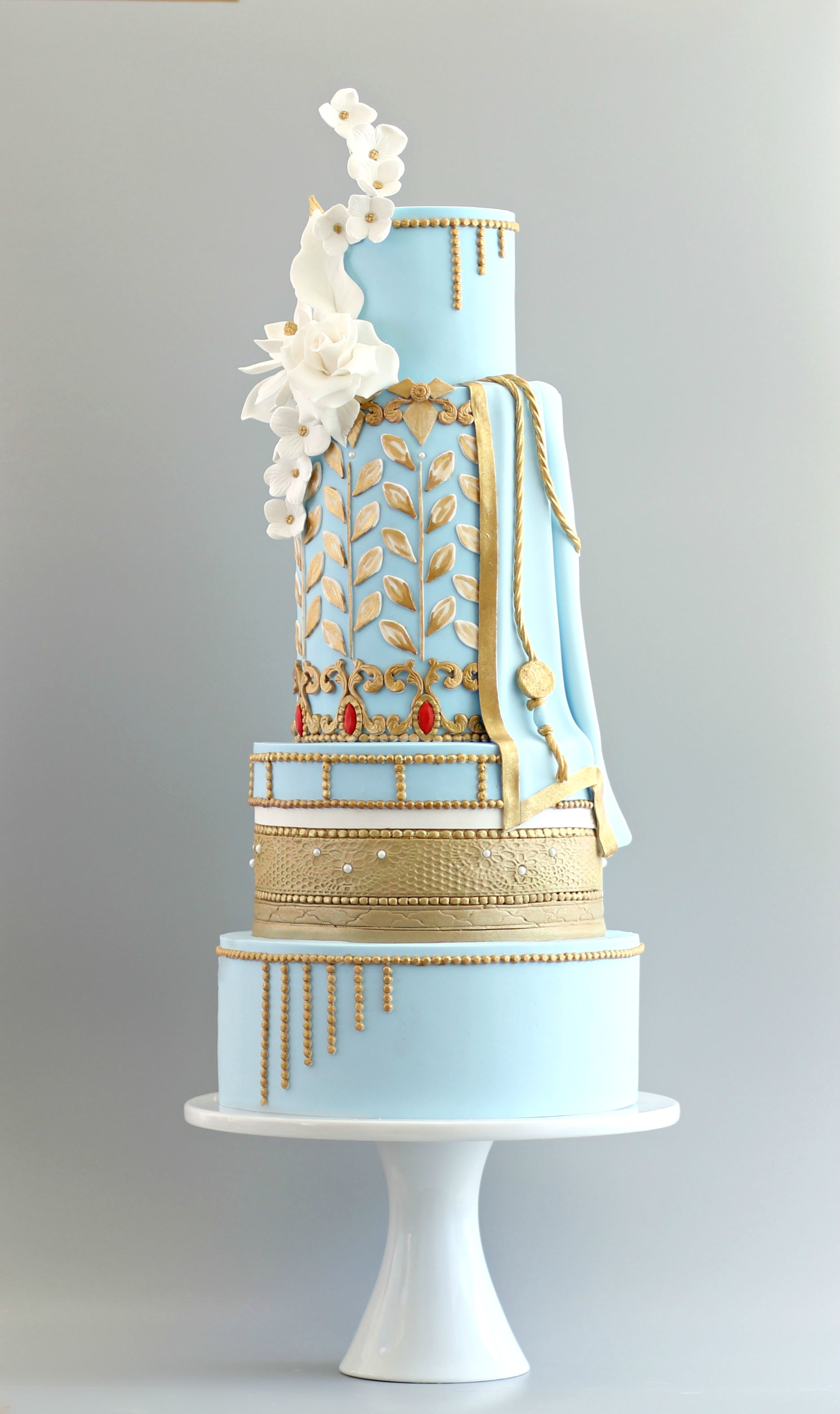 Light blue and gold indian inspired wedding cake