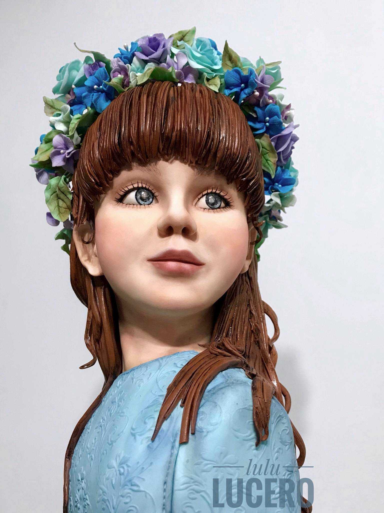 Sculpted young girl with floral wreath bust cake
