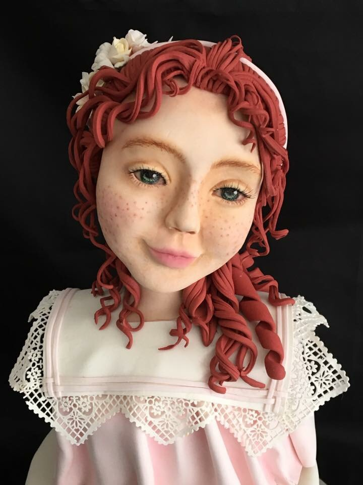 Little girl with red hair bust cake