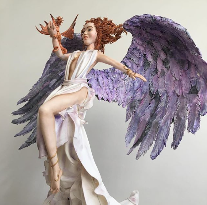 Mythical angel with wings figurine
