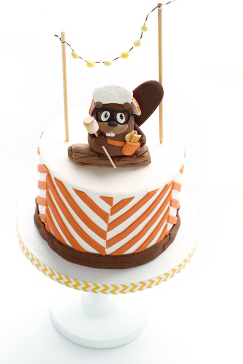 orange and white mini cake with chipmunk topper