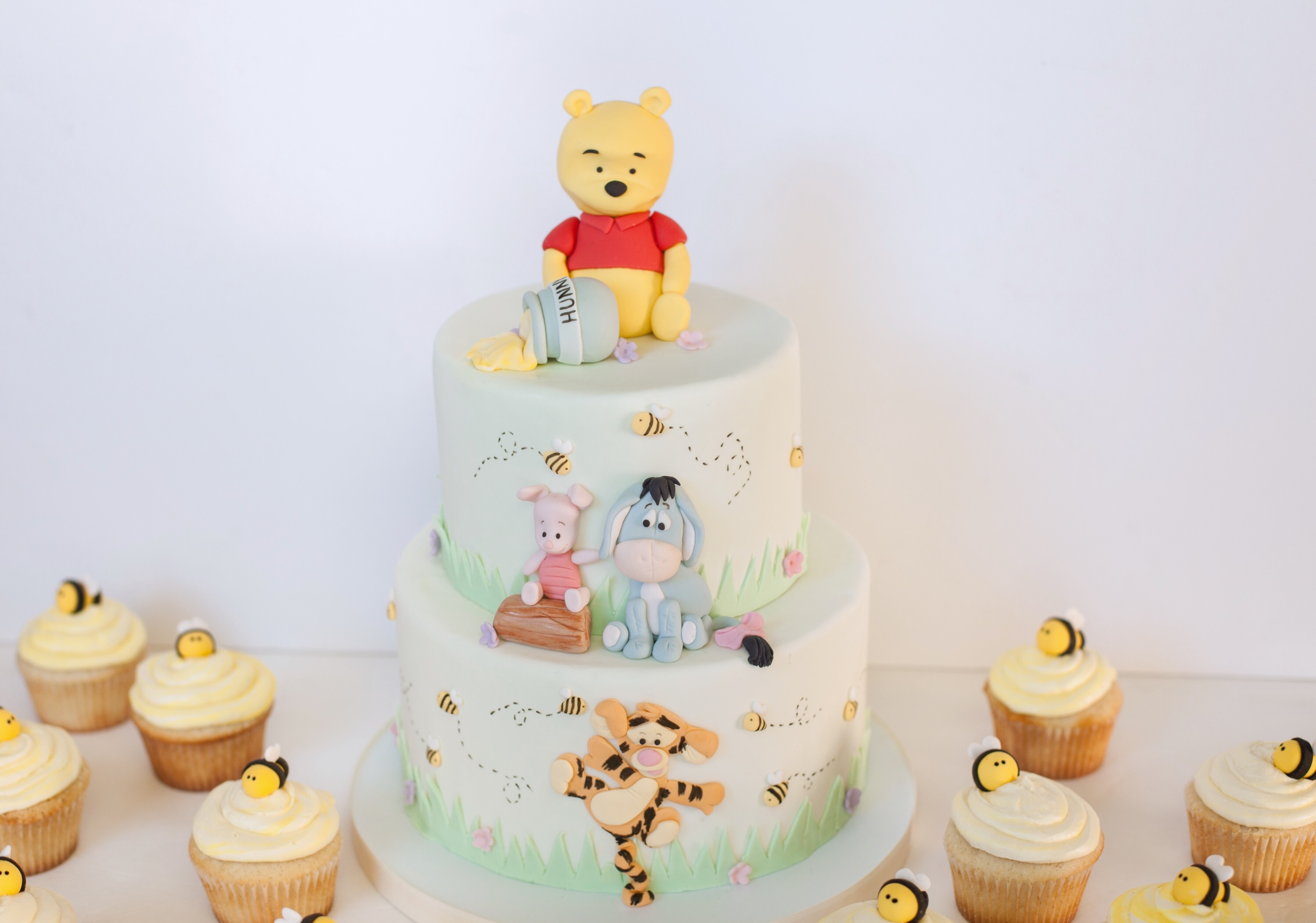 Winnie the Pooh Birthday cake and cupcakes