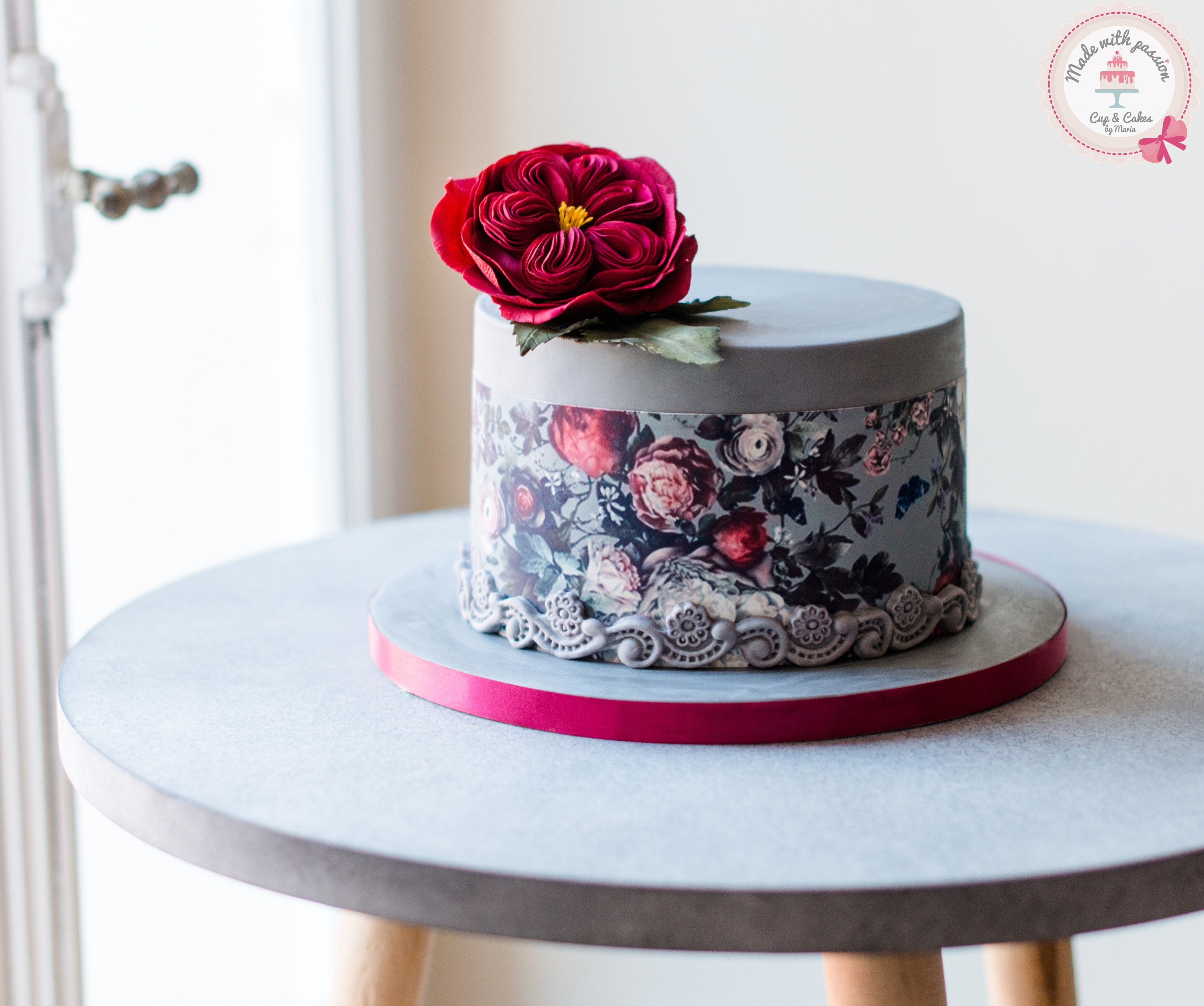 Mini gray cake with hand painted flowers