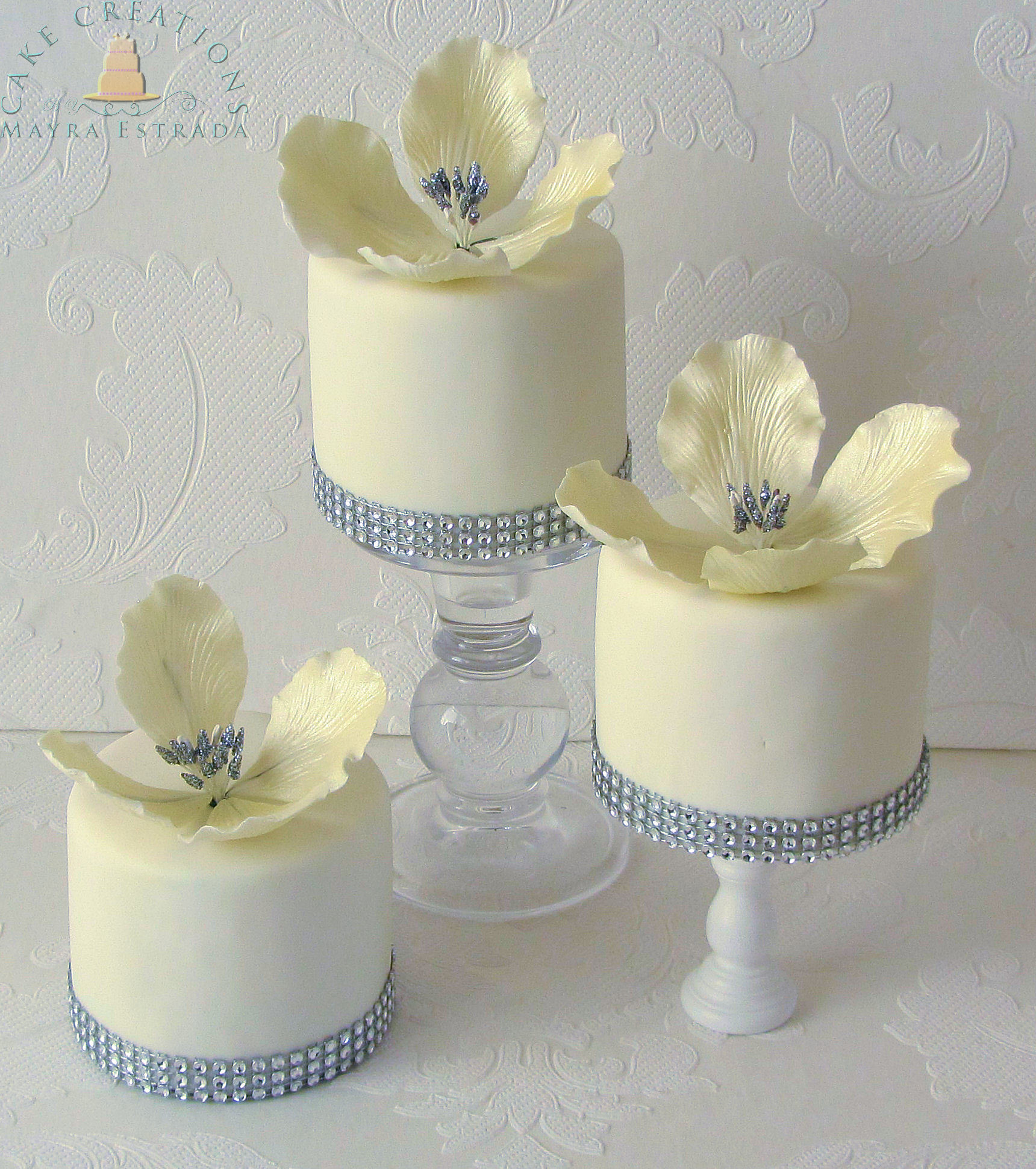 White fondant petite fours with sugar flowers
