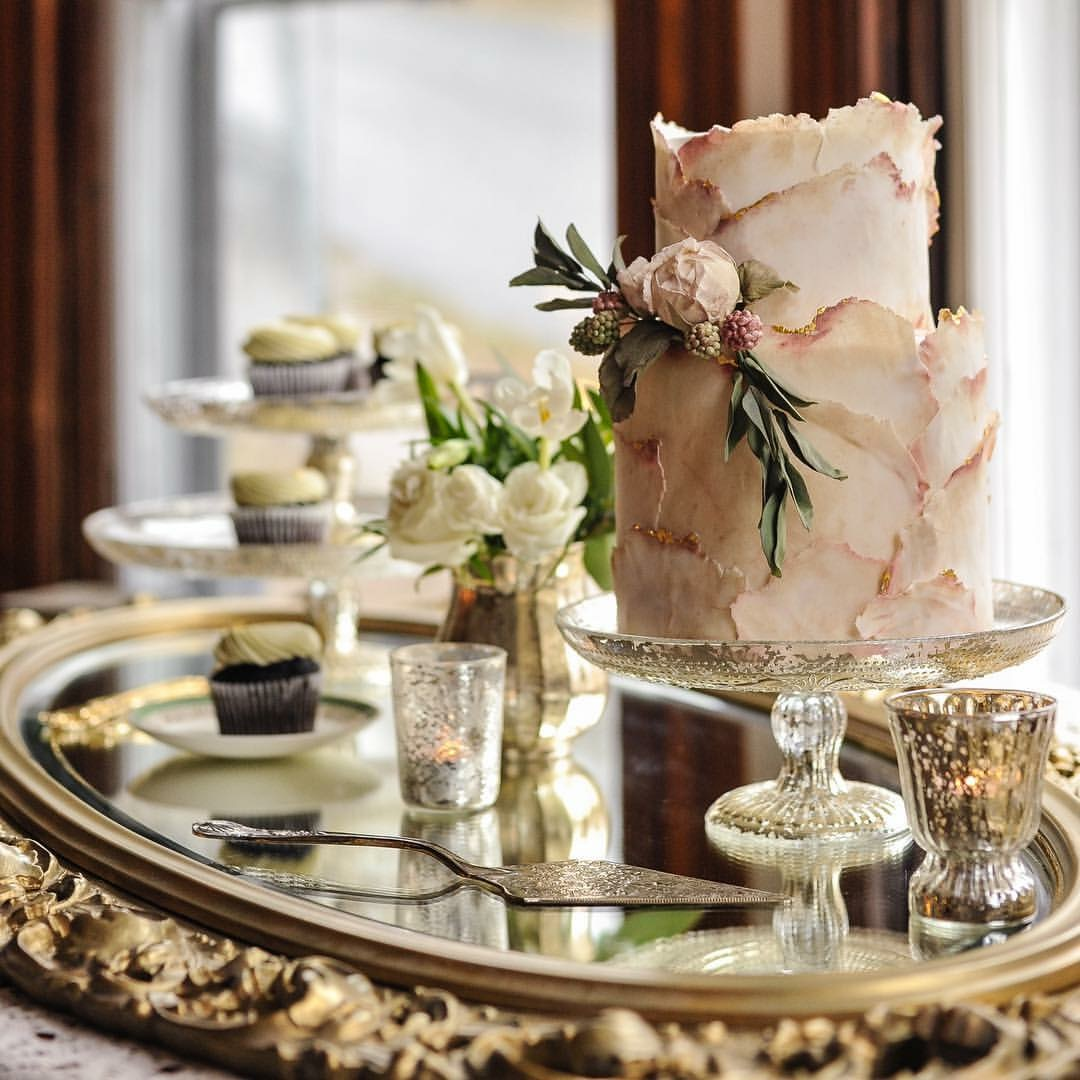 White with gold bas relief wedding cake