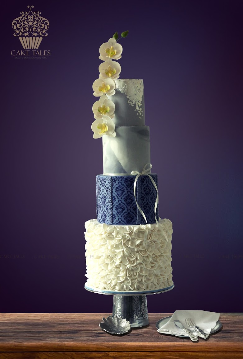 blue silver and white ruffle wedding cake