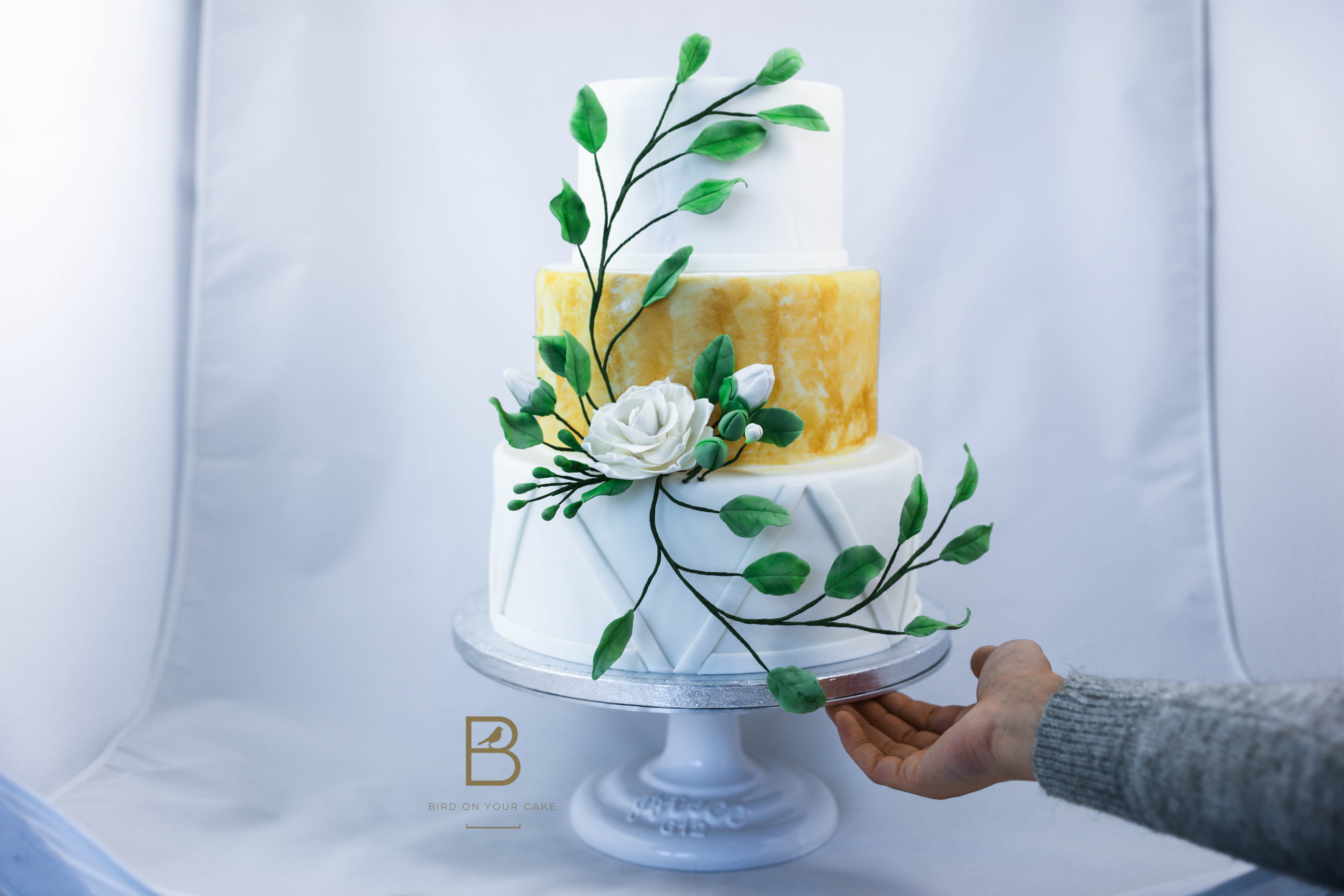 White wedding with yellow and sugar flowers