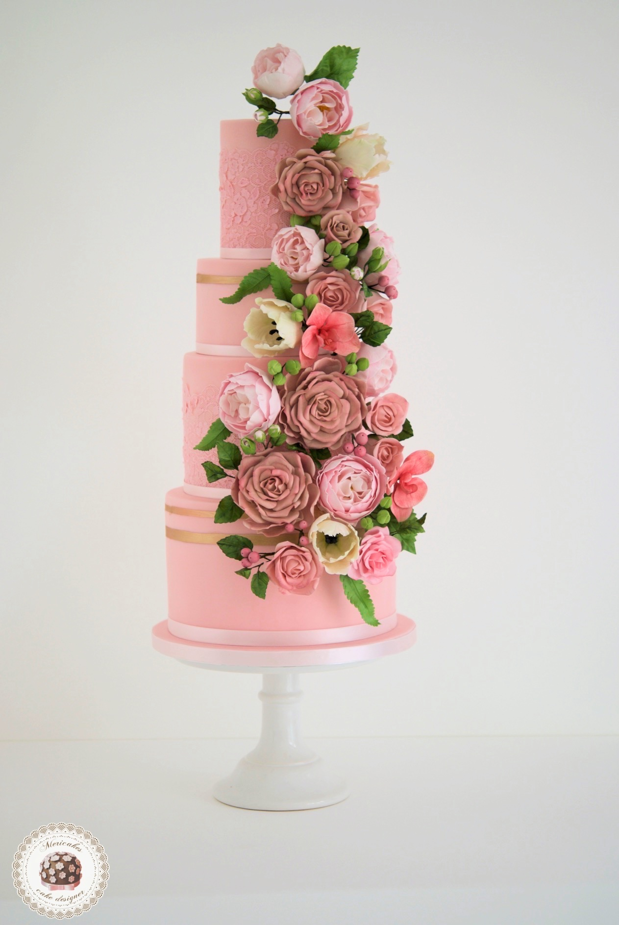 Pink wedding cake with cascading sugar roses
