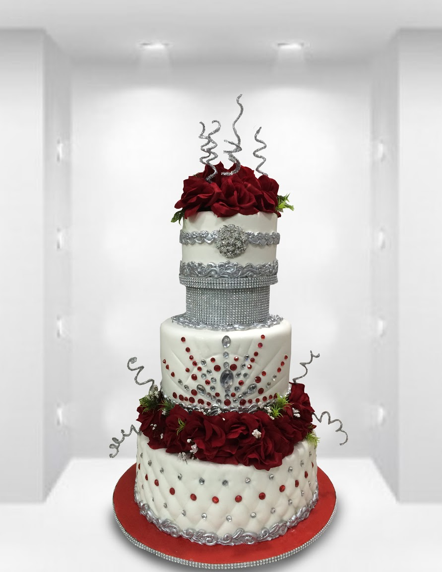 White wedding cake with red sugar roses