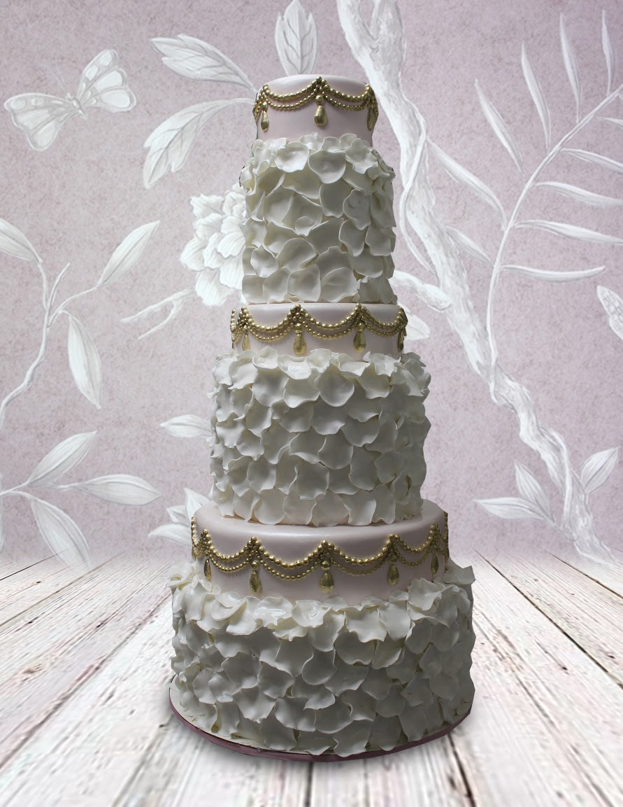 White and ivory wedding cake with ruffles