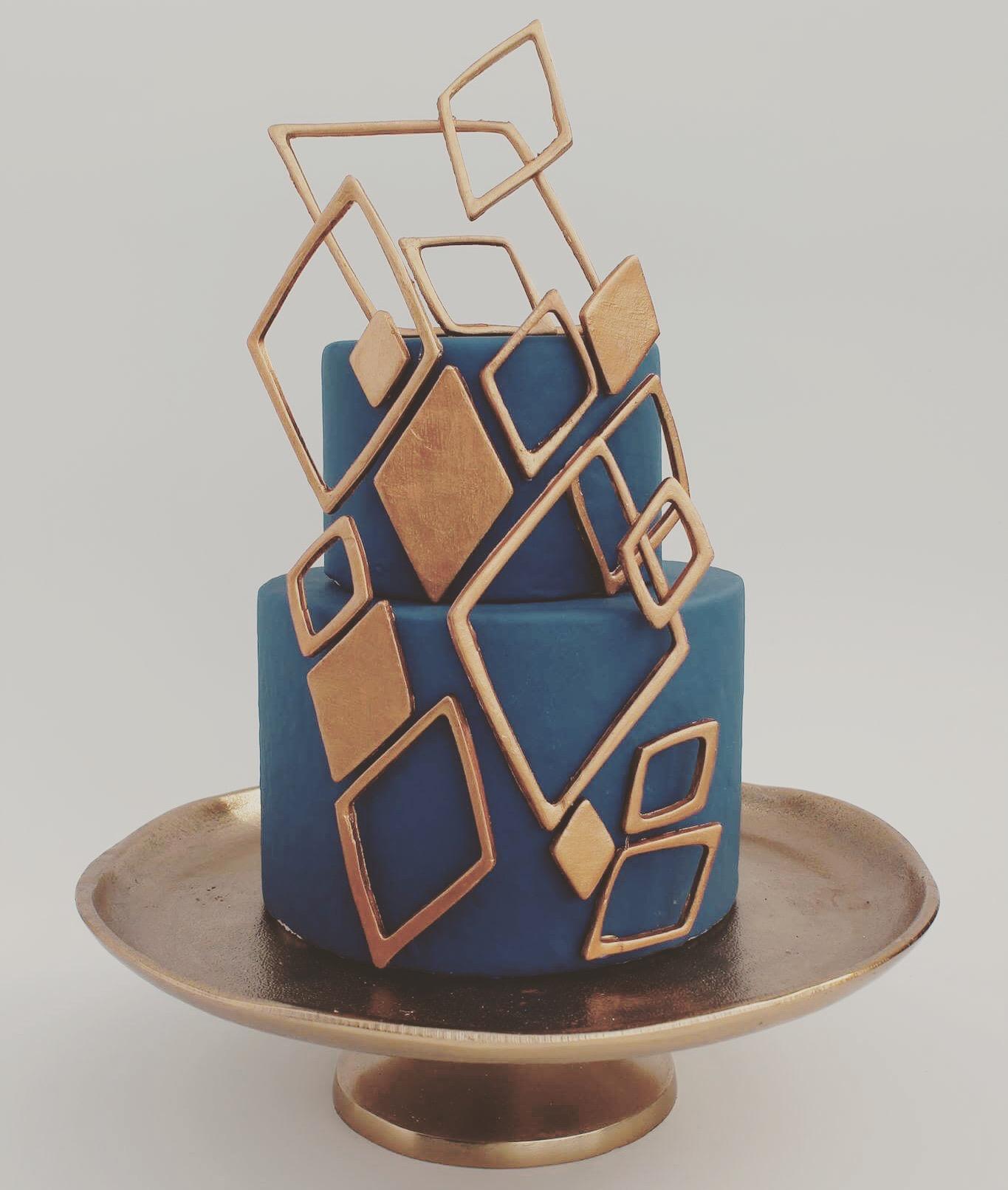 Navy Blue and gold geometric wedding cake