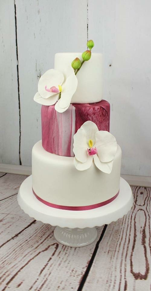 White and pink wedding cake with sugar lilies