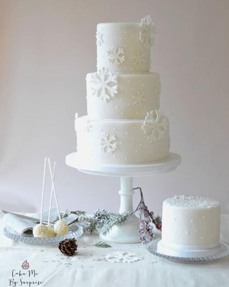 All white wedding cake with snowflakes