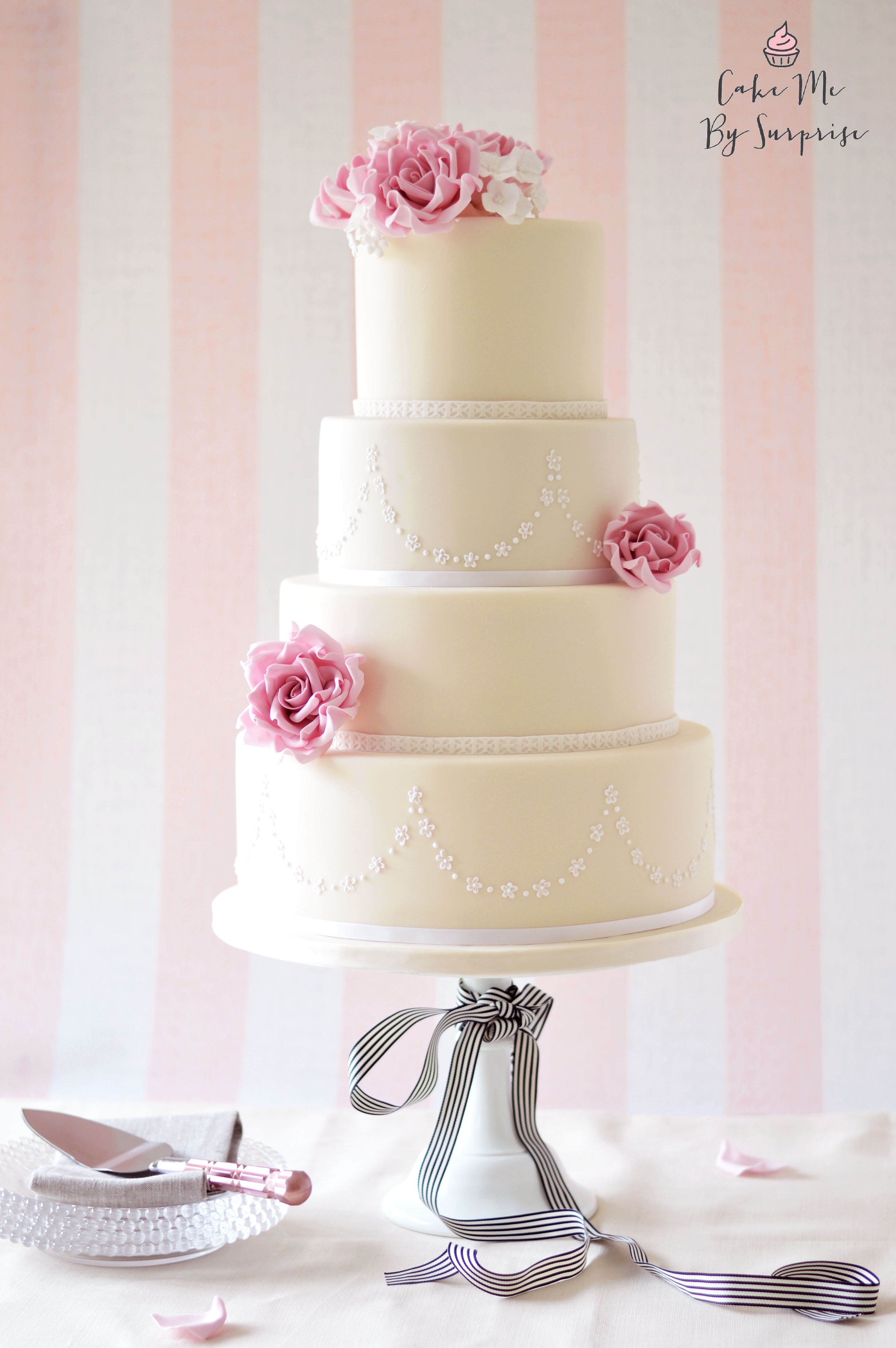 Ivory wedding cake with pink sugar flowers