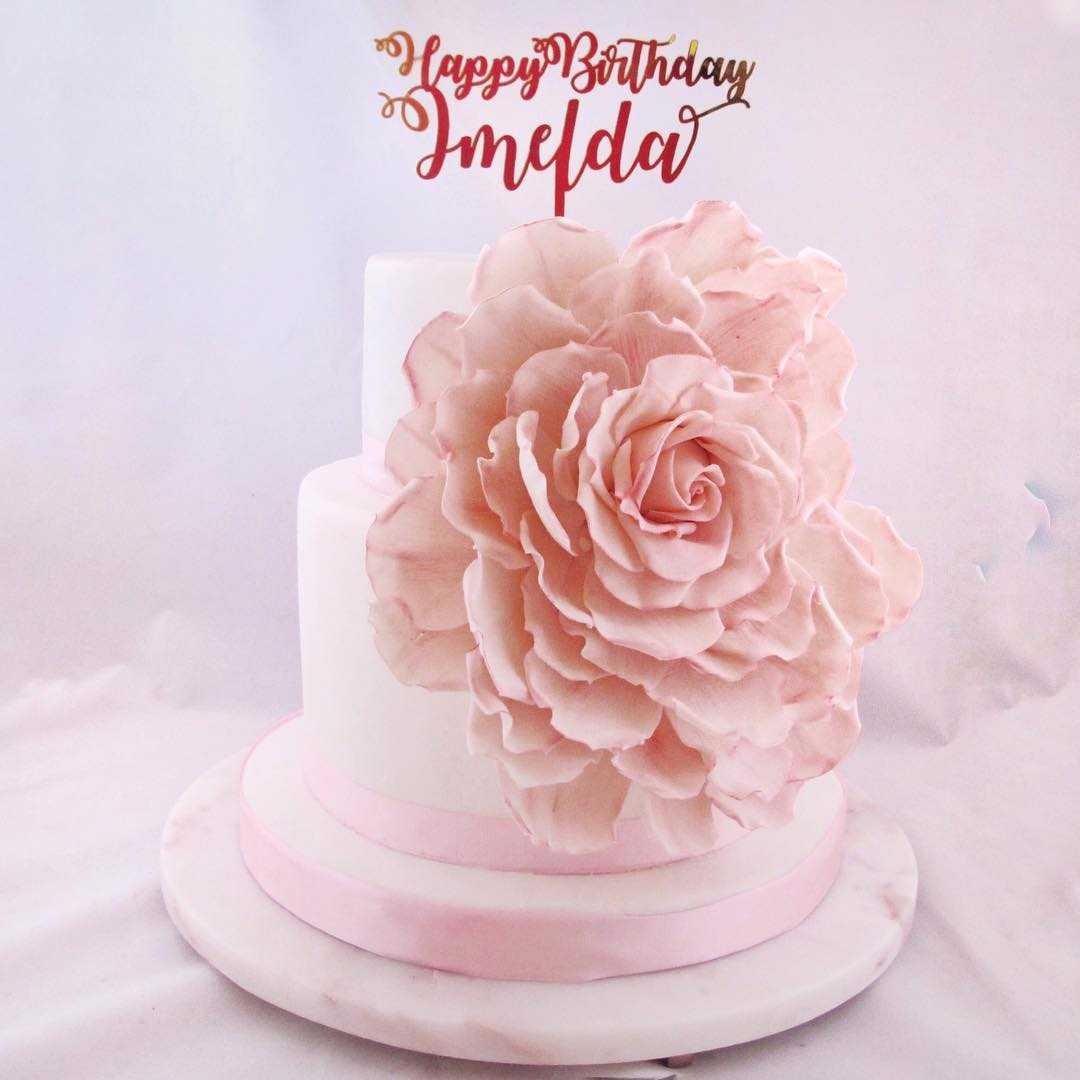 Pink cake with sugar flower birthday