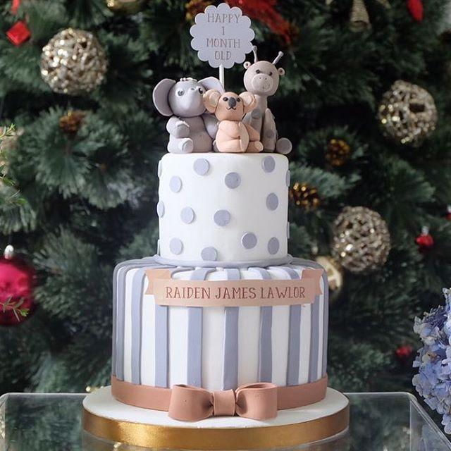 Gray and white striped and  polka dot baby cake