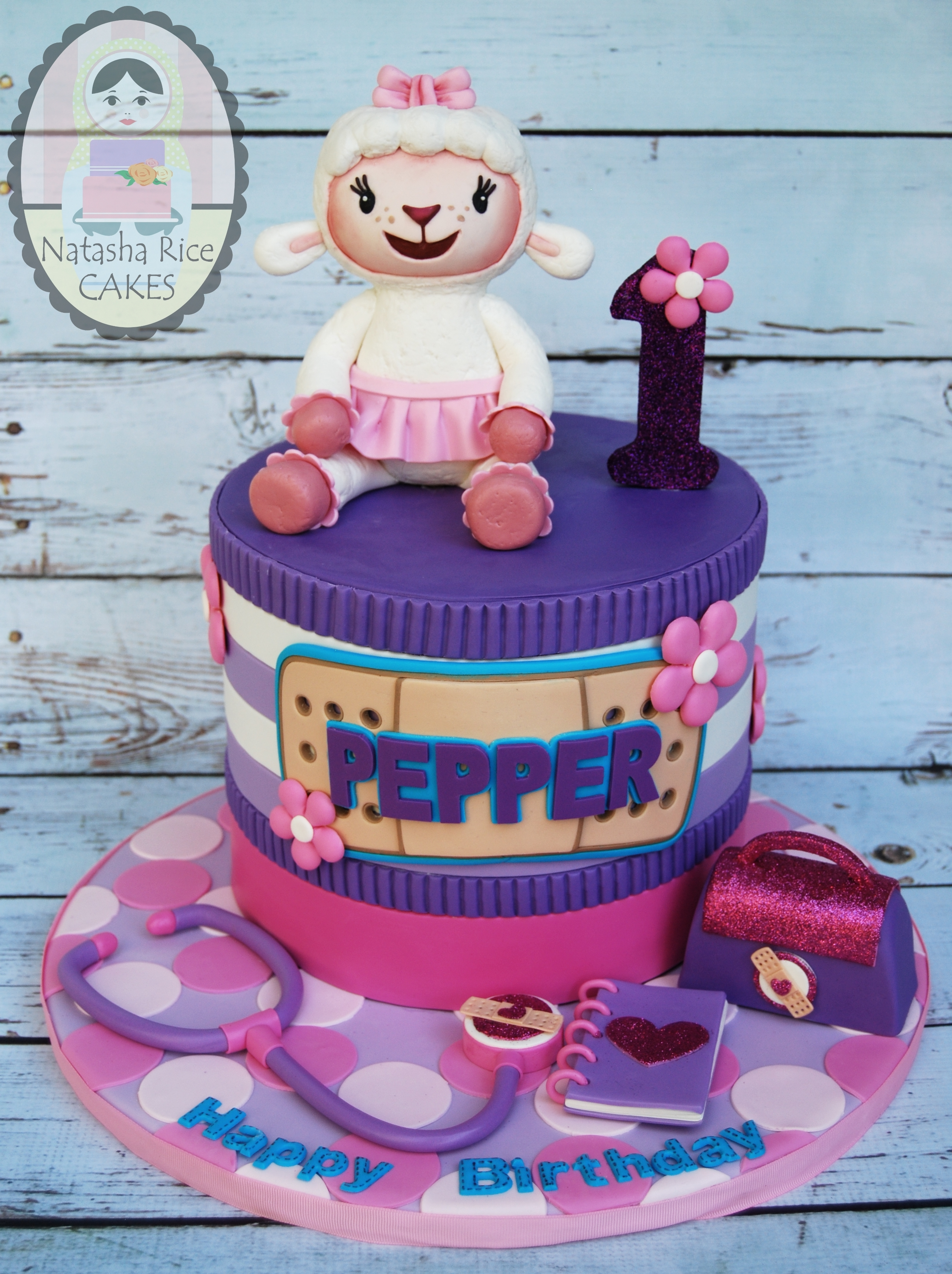 Purple and Pink Doc McStuffins Cake
