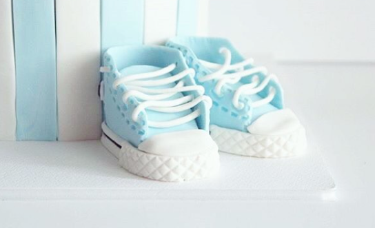 Blue and white fondant baby shoes