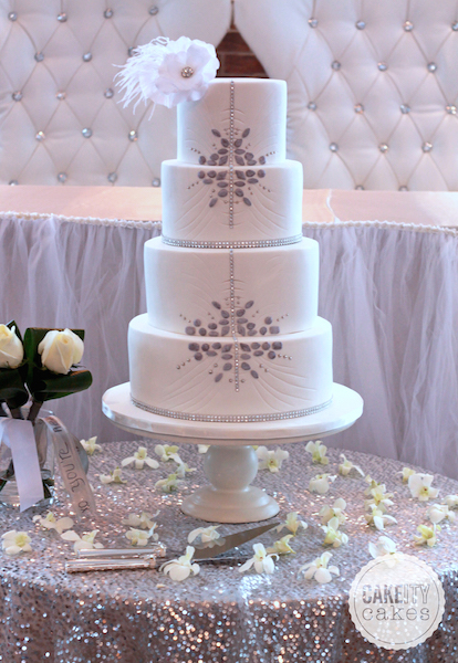 White wedding cake with silver design