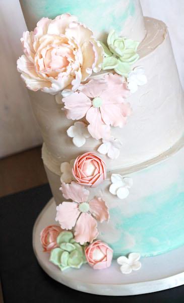 Pastel sugar flowers and watercolored wedding cake