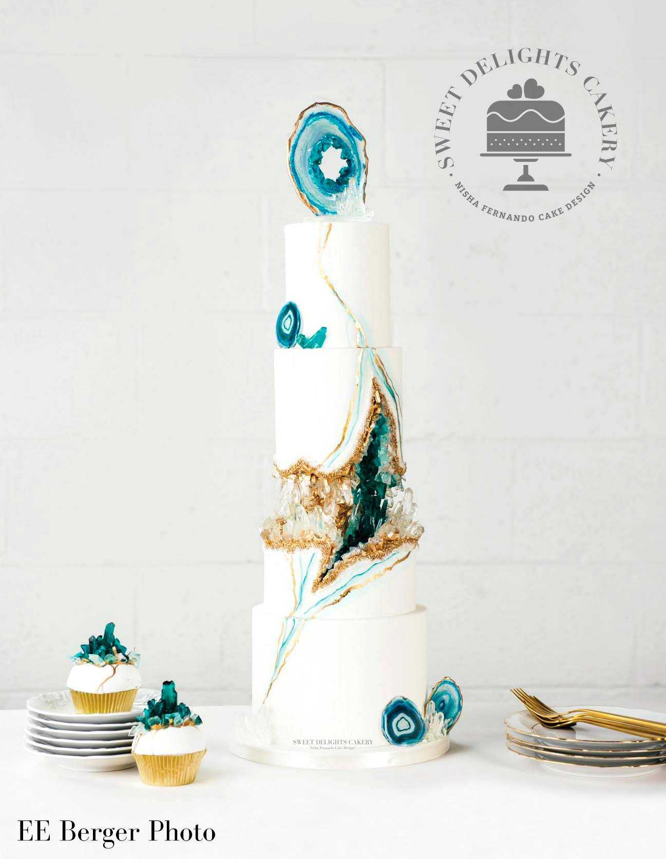 White with teal rock geode wedding cake and cupcakes