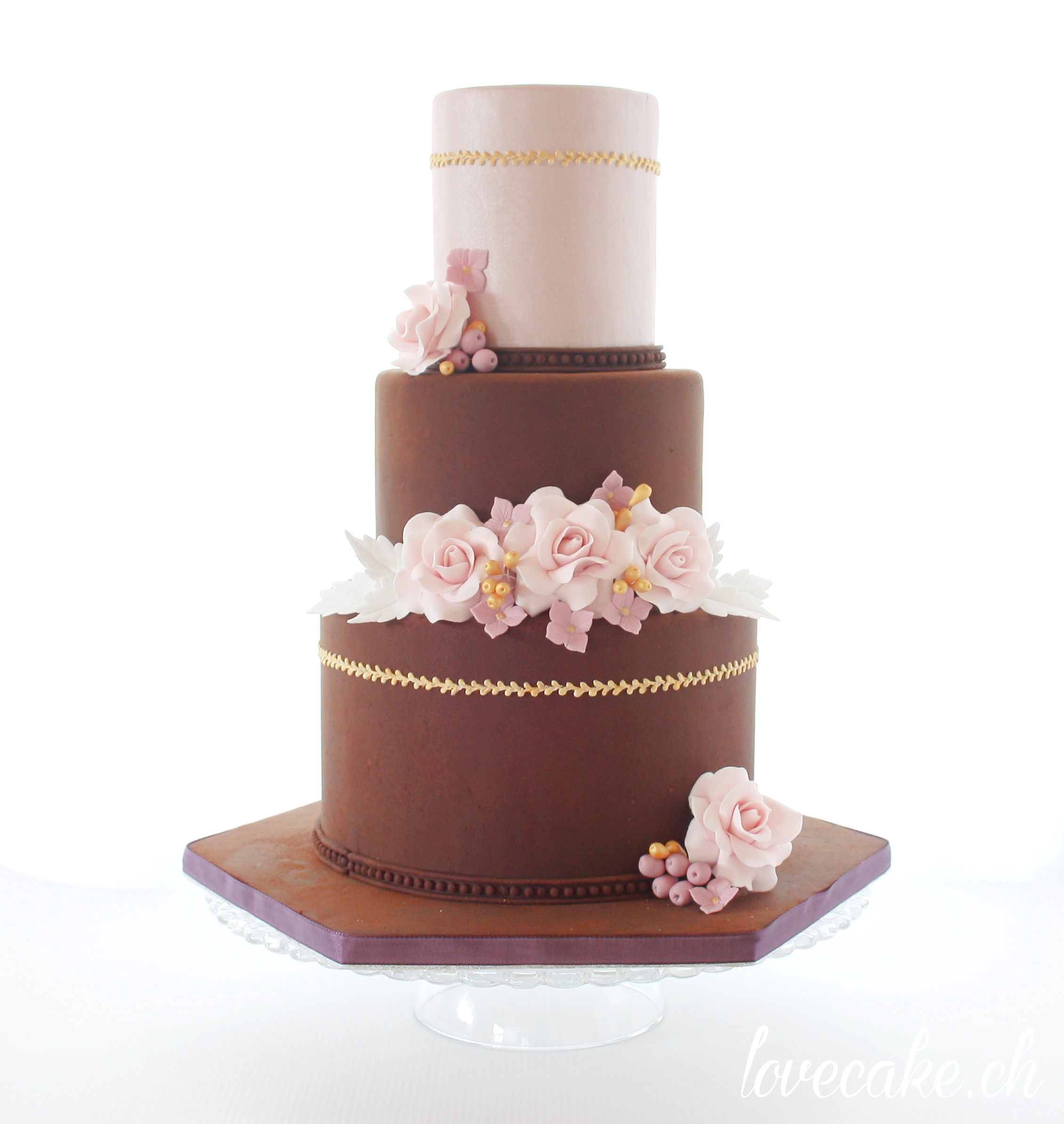 Chocolate and pink wedding cake with pink sugar flowers
