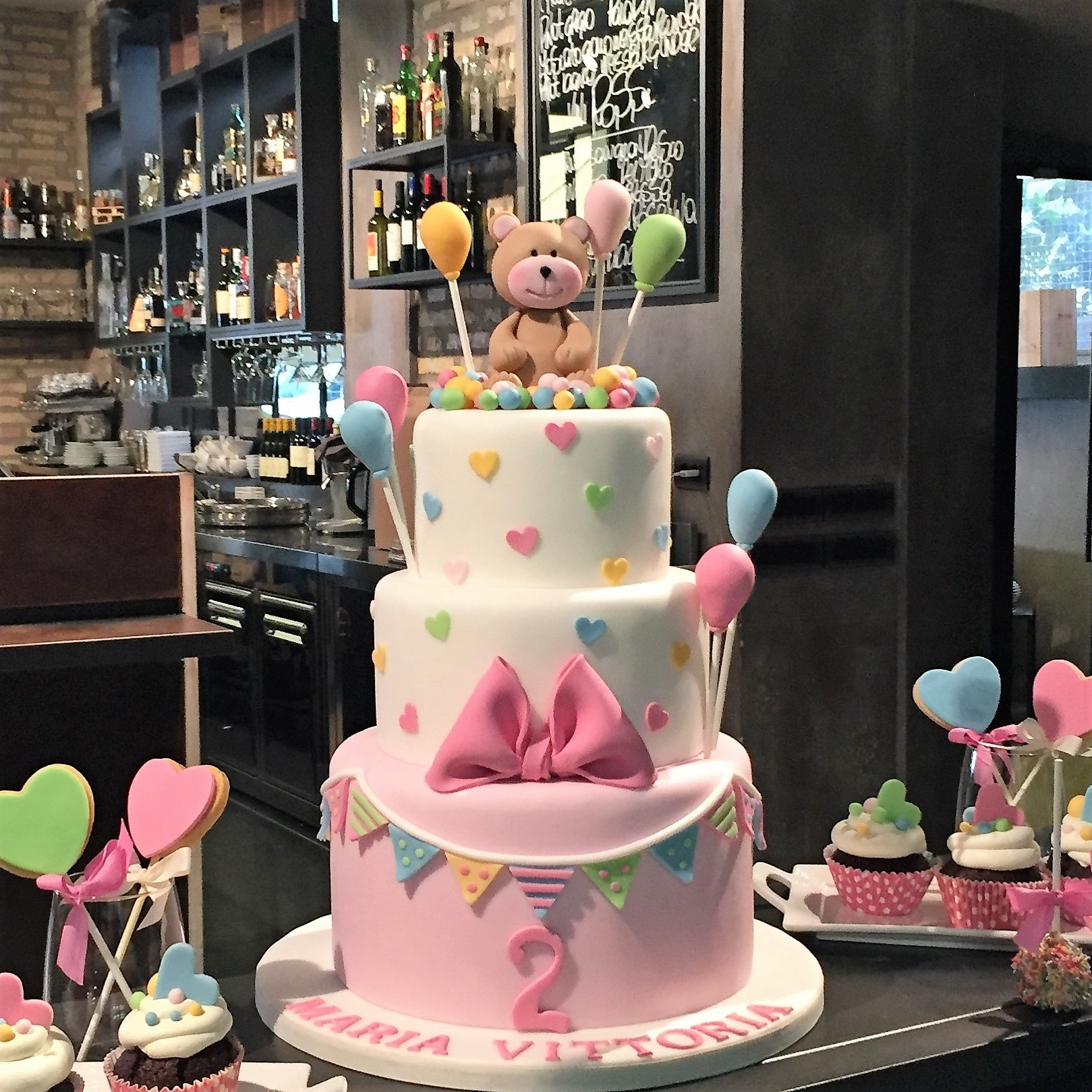 Pink and white teddy bear birthday cake