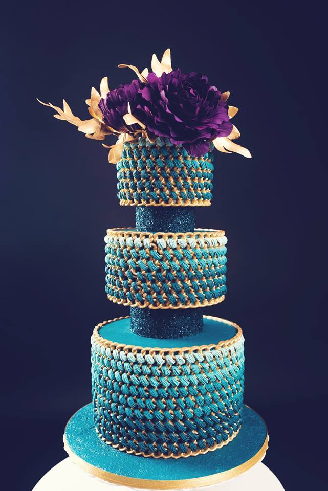 Perfectly Peacock themed wedding cake